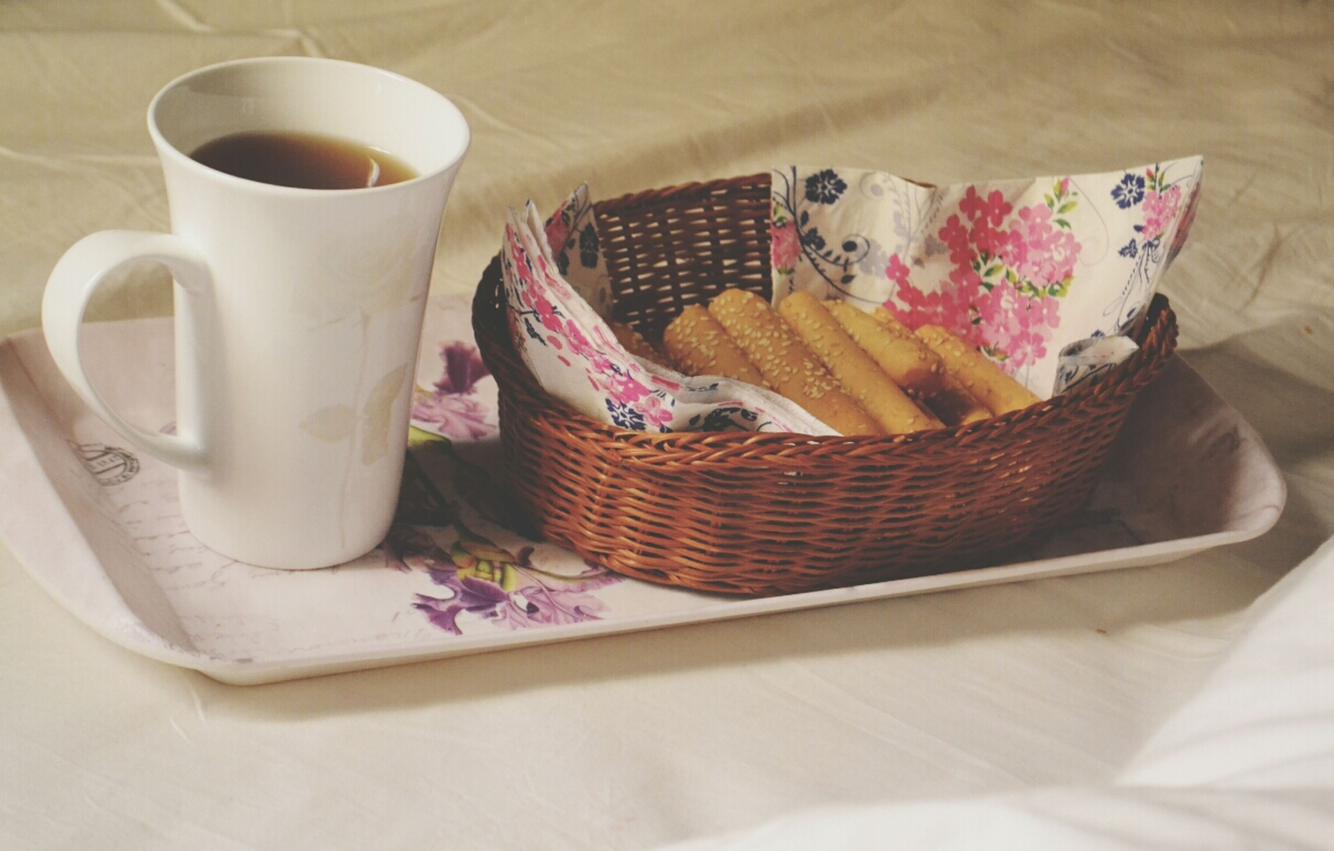 indoors, table, still life, high angle view, coffee cup, food and drink, plate, cup, tablecloth, no people, bed, home interior, sweet food, freshness, close-up, paper, coffee - drink, creativity, book, white color