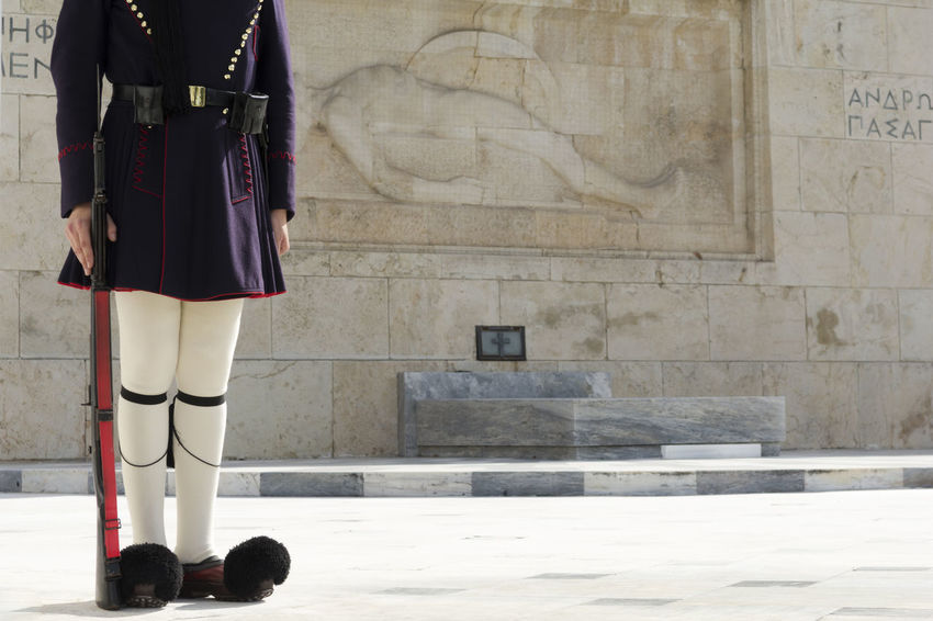 Greek traditional soldier front of the tomb of the Unknown Soldier in Athens, Greece. Elite Evzoni Government Greek National Patriotic Soldier Tomb Uniform Unknown Clothing Costume Guard Honor Landmark Military One Parliament Presidential Rifle Standing Syntagma Square Traditional Travel Destinations Tsolias
