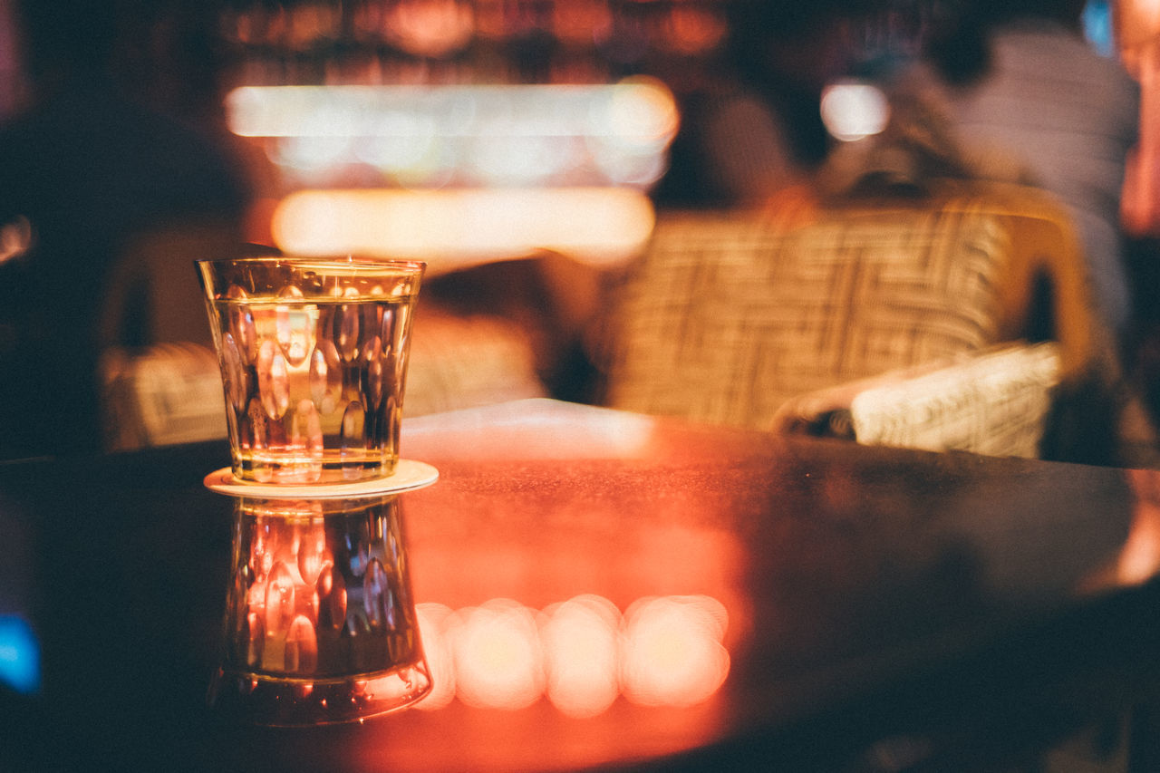 Alcohol Bar - Drink Establishment Bokeh Lights Close-up Drink Drinking Glass Focus On Foreground Freshness Indoors  Moody People Table