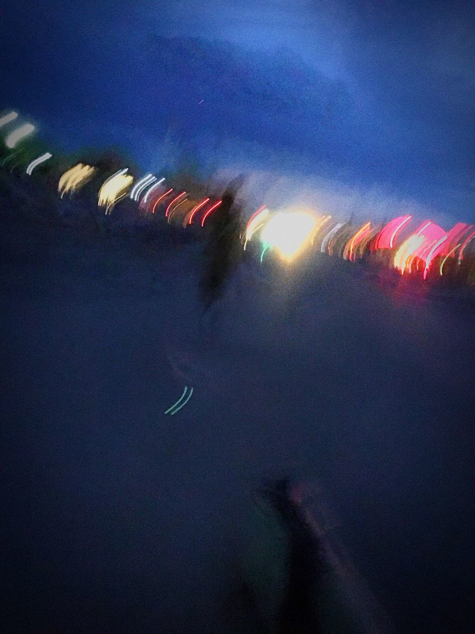 arts culture and entertainment, night, blurred motion, illuminated, long exposure, event, multi colored, low angle view, sky, outdoors, motion, no people, nature