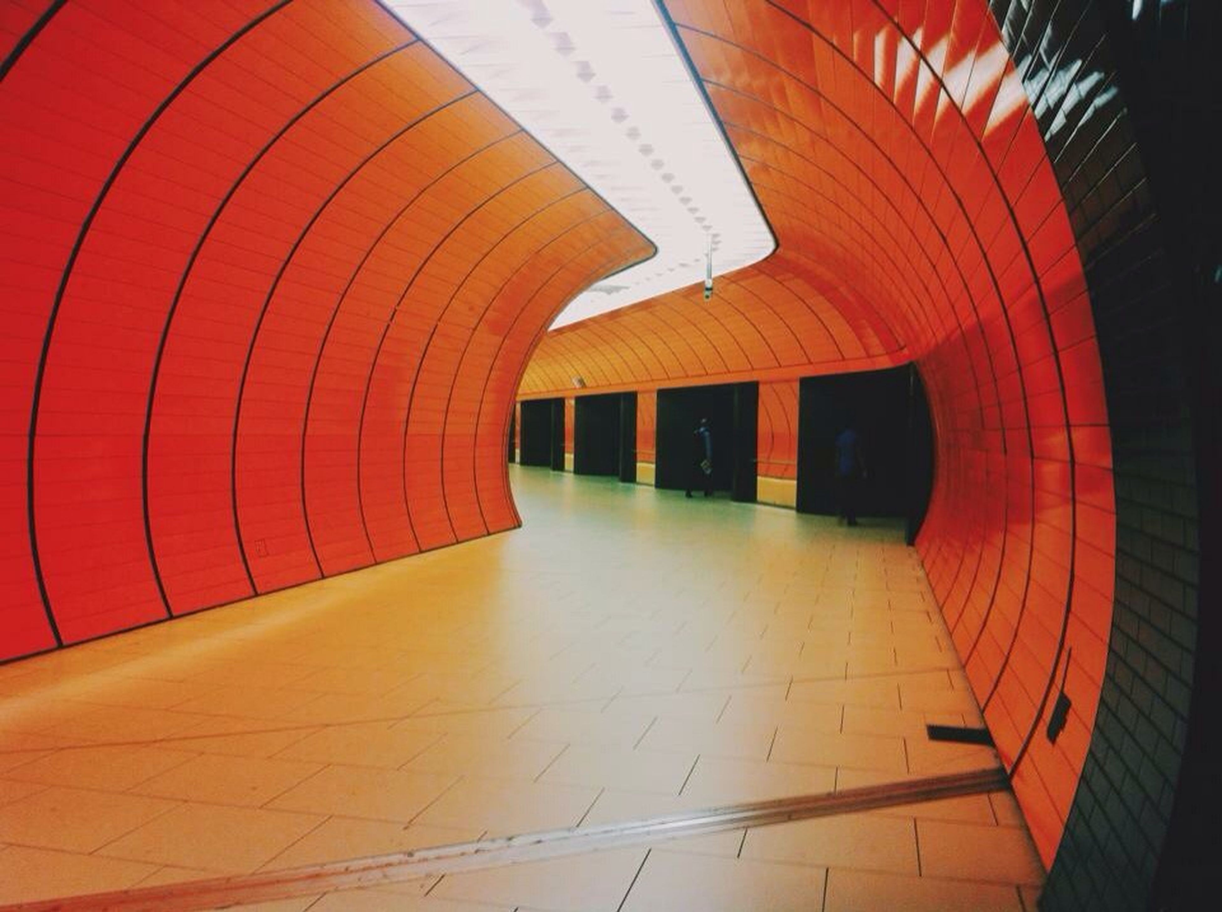 indoors, built structure, architecture, the way forward, red, empty, diminishing perspective, modern, building exterior, in a row, building, pattern, no people, wall - building feature, absence, steps, illuminated, steps and staircases, vanishing point, railing