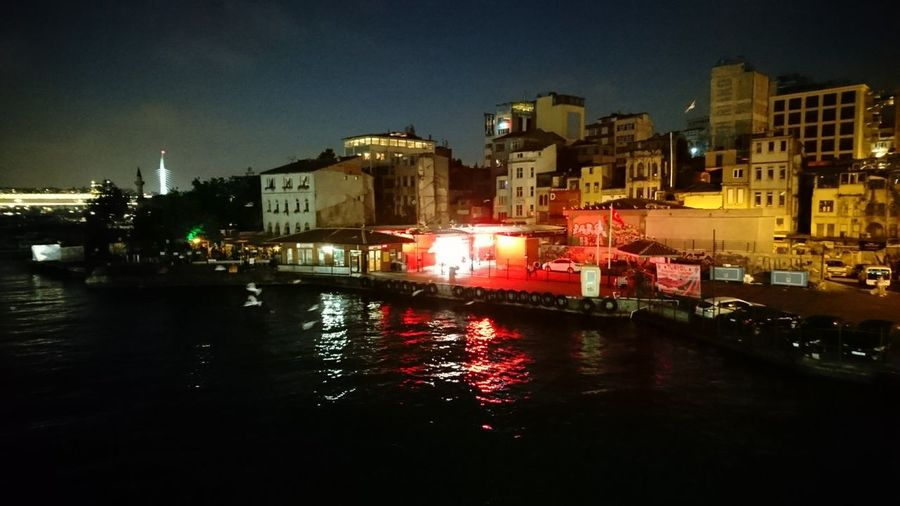 Istanbul red. · Istanbul Turkey Eurasia Bosphorus Bridge View From A Bridge Waterfront Dwellings Shops Red Work Urban Landscape Cityscape Night Lights Night Life Night Photography