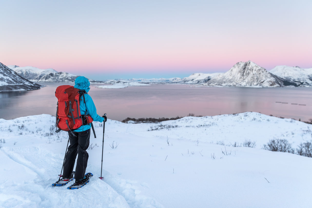 Adult Adults Only Adventure Beauty In Nature Cold Temperature Day Full Length Glacier Hiking Ice Landscape Mountain Nature Norway One Person Only Men Outdoors Pastel Power Rear View Scenics Snow Snowshoeing Vesterålen Warm Clothing Winter