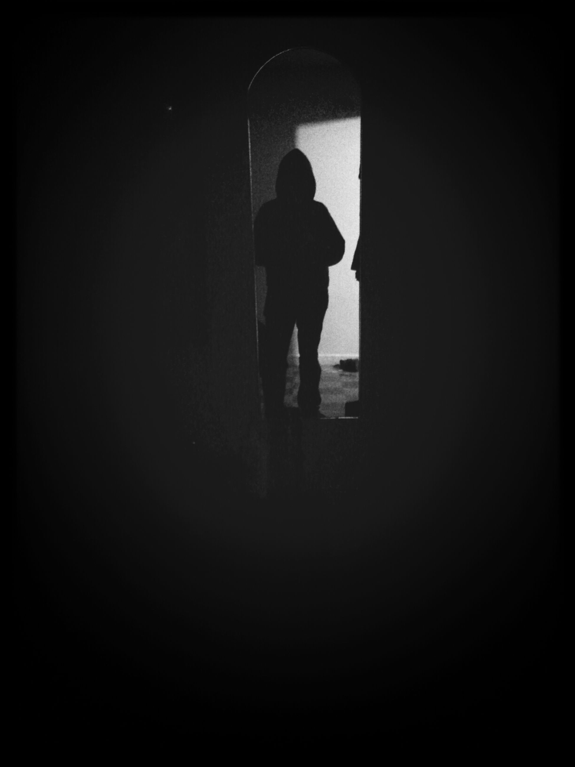 indoors, silhouette, lifestyles, men, full length, dark, rear view, standing, copy space, leisure activity, walking, tunnel, person, wall - building feature, side view, unrecognizable person, night