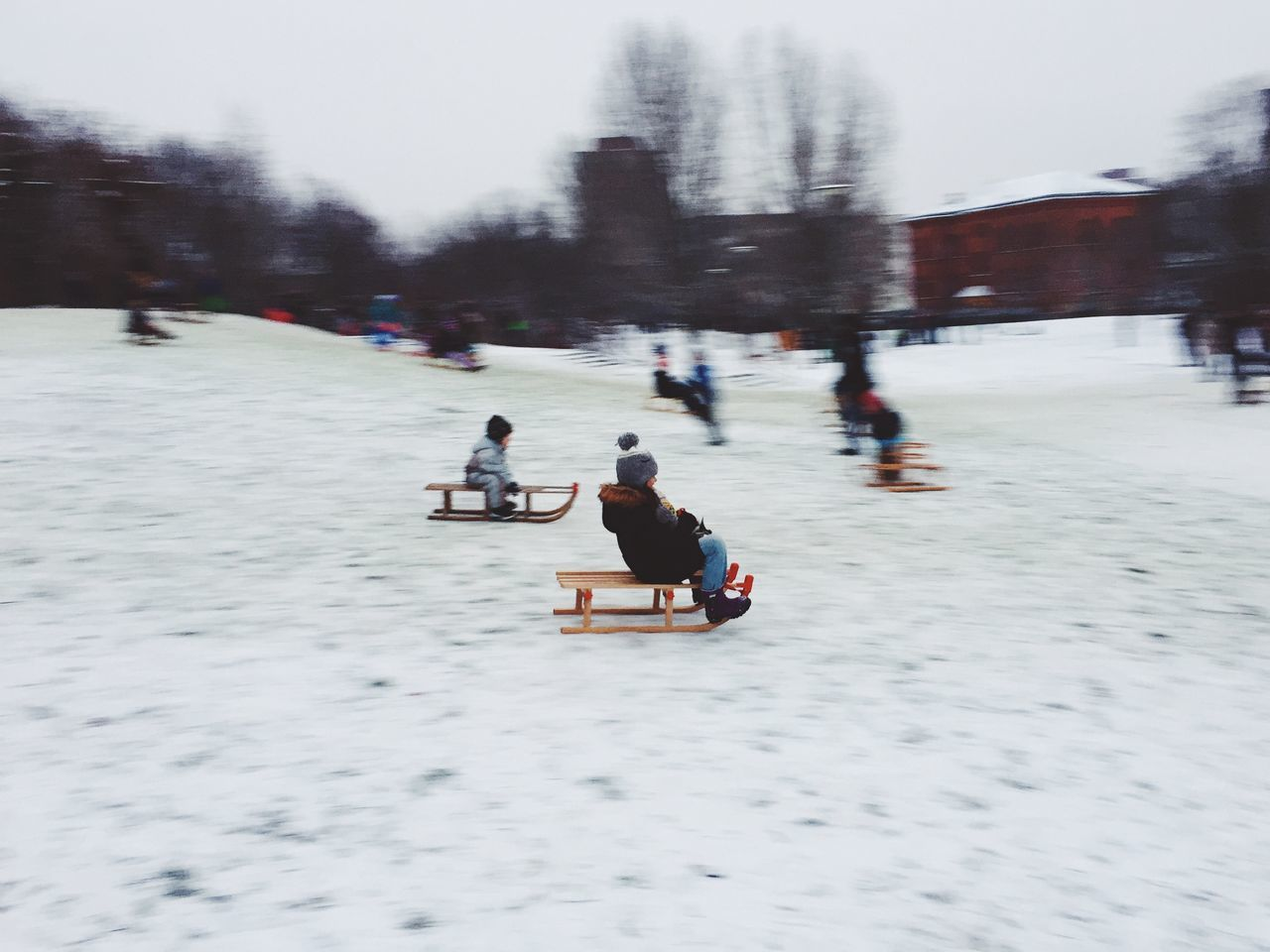 Perfect day for the Kids. #1 Berlin Berlin Photography Berliner Ansichten Blur Blurred Motion Children Cold Temperature Day Ice Rink Kids Move Movement Nature Outdoors People Playing Real People Sled Sledding Snow Snow ❄ Tree Winter Winter Winter Sport