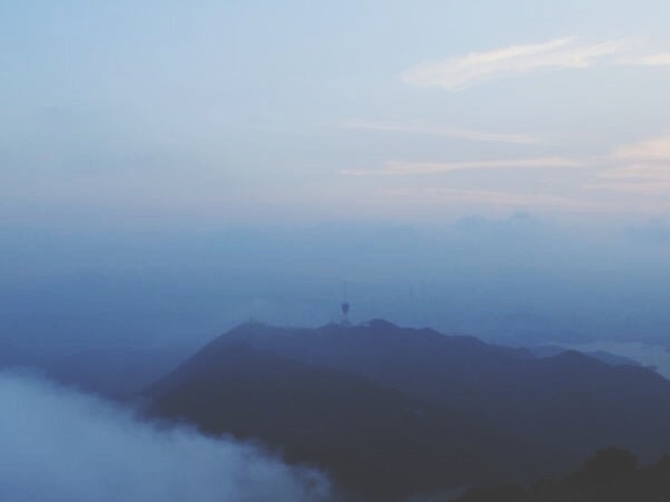 scenics, tranquil scene, tranquility, beauty in nature, fog, mountain, sky, nature, idyllic, foggy, water, landscape, cloud - sky, sea, weather, non-urban scene, mountain range, remote, dusk, outdoors