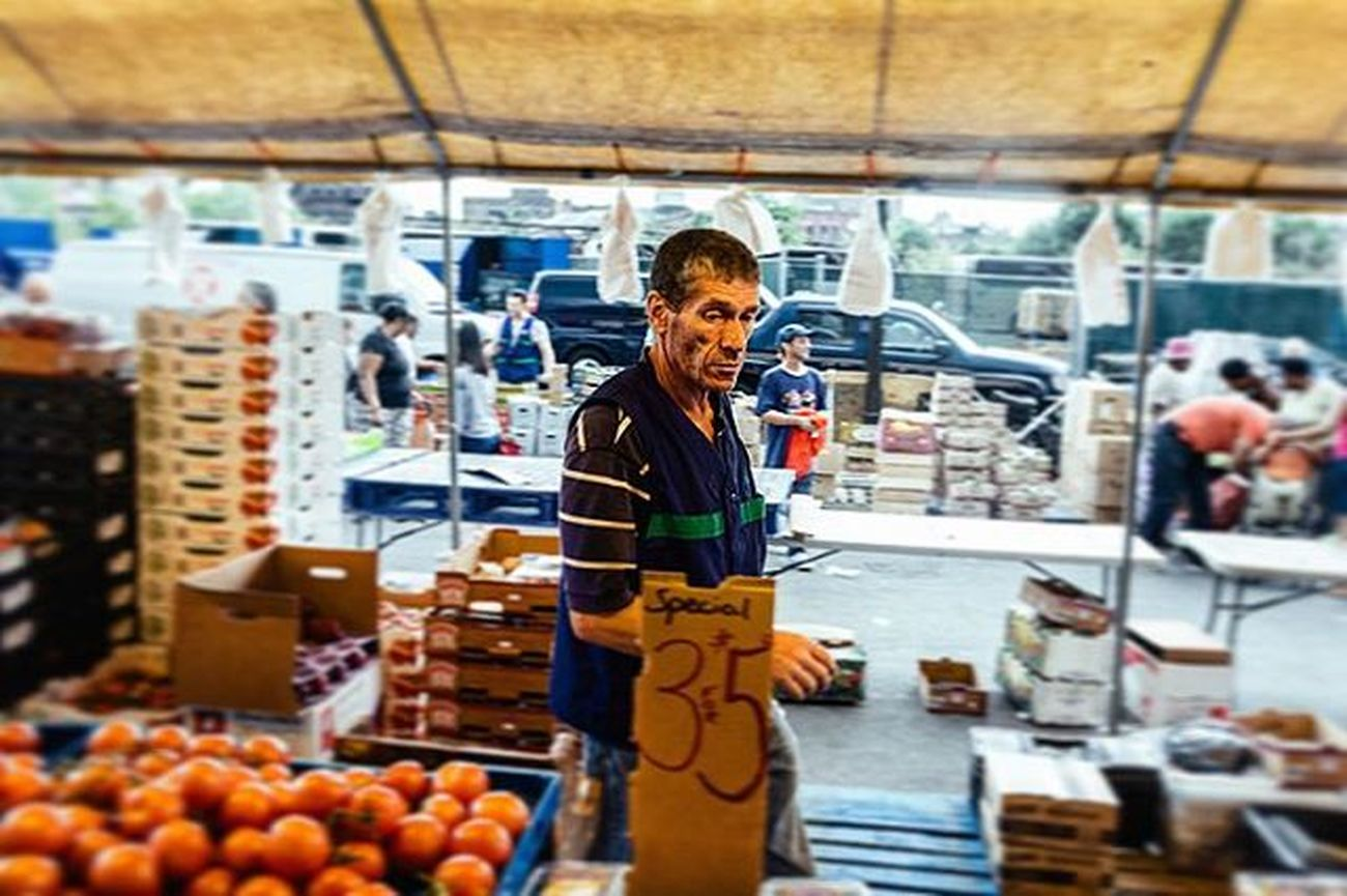 A merchant at a city Farmer's Market in downtown Boston. They were ending the day so people were everywhere trying to get the best deal possible. Fresh Market Boston Bestoftheday Deal Freshfruit Freshveggies Followme Lfl Specials Follow Economy Family Packingup Love Endoftheday Candid 3for5 Packed Tomatos Tents Streetphotography Instafollow Instagood Instadaily ztprod