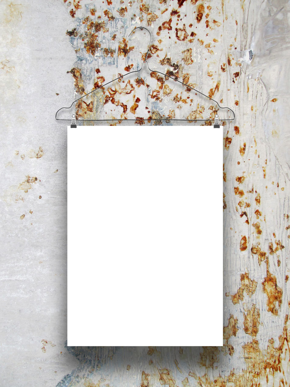 Close-up of paper sheet frame with clothes hanger on rusty metal background 2015  A4 Background Clothes Hanger Copy Space Deterioration Dirty Empty Frame Ideas Paper Photo Rectangular Frame Rusty Metal Single Object Studio Shot Text Textures And Surfaces Vertical Wall White