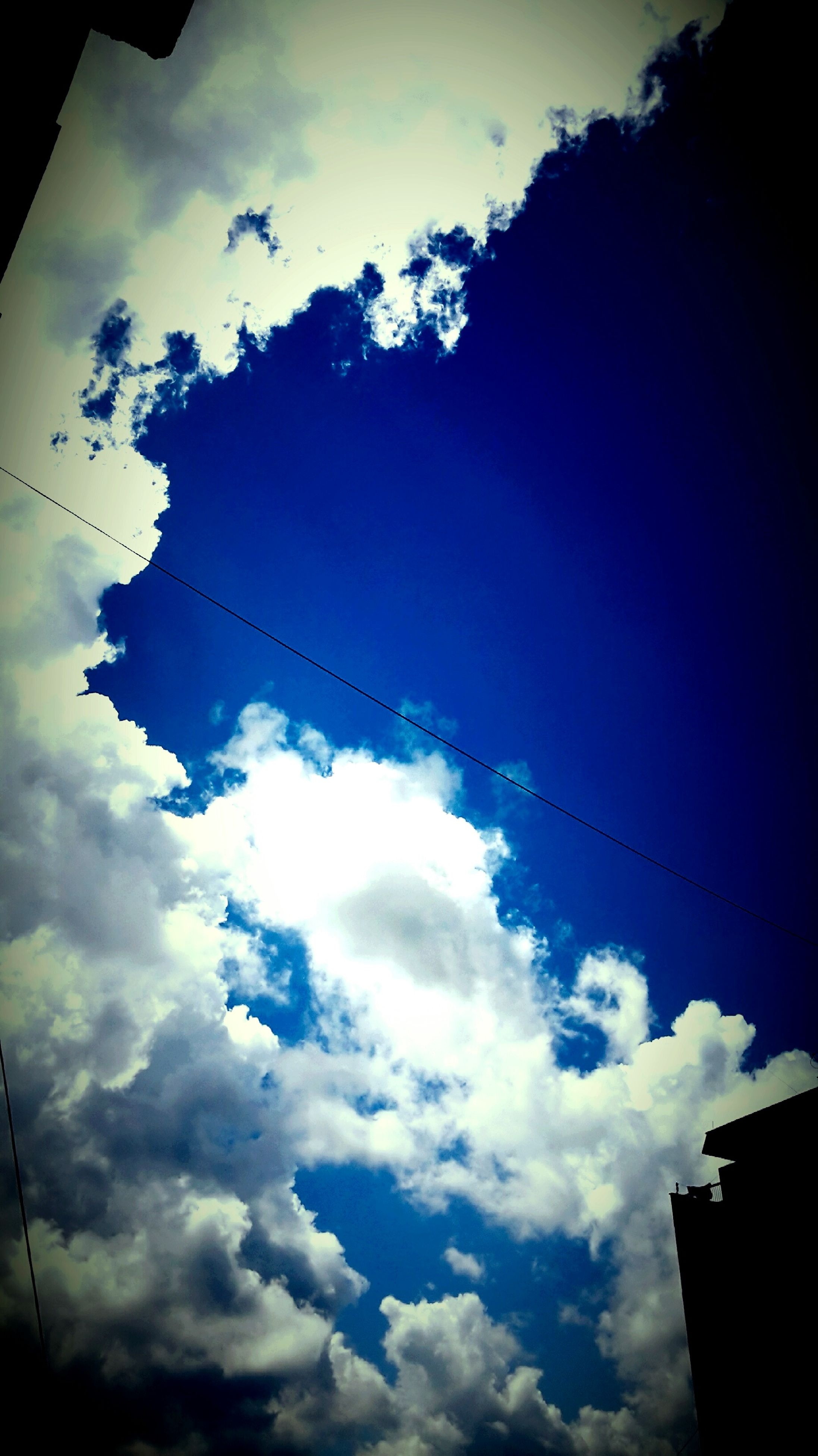 low angle view, sky, cloud - sky, cloudy, silhouette, power line, cloud, cable, nature, beauty in nature, weather, electricity, scenics, dusk, outdoors, tranquility, high section, built structure, overcast, no people