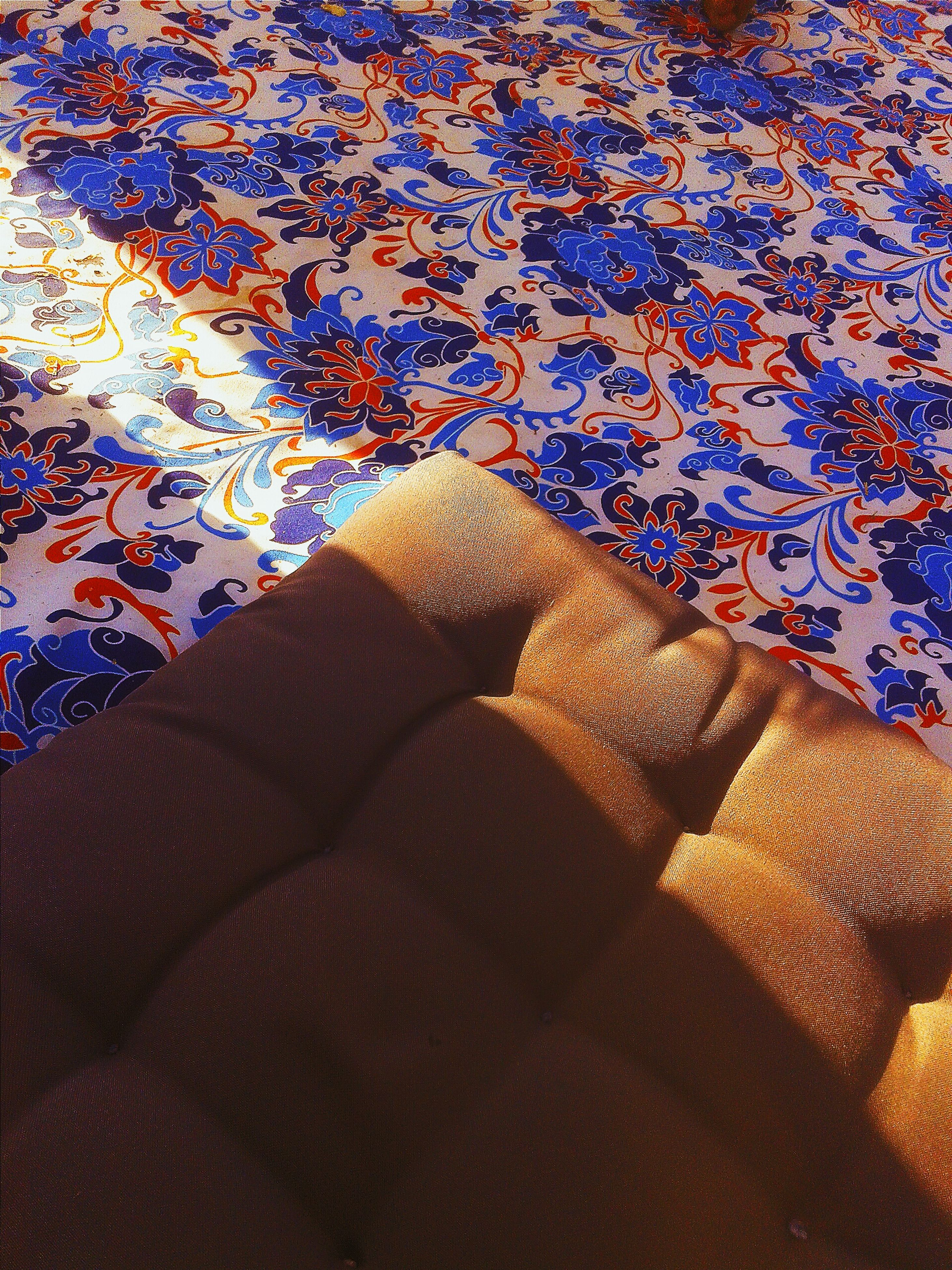 low section, person, high angle view, pattern, indoors, sunlight, shadow, day, textile, part of, relaxation, personal perspective, lifestyles, wall - building feature, close-up, textured