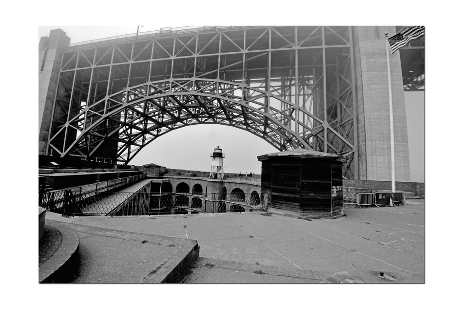 Golden Gate Bridge @ Fort Point 5 San Francisco Bay Golden Gate Bridge 1937 Fort Point 1861 Lighthouse Fog Foggy Day Bnw_friday_challenge Military Base U.S.Flag Diminishing Perspective Arch Bridge Arch Bridge Span Bridge Tower Vanishing Point Fort Structure Barracks Monochrome Black & White Black And White Photography Black And White Black And White Collection