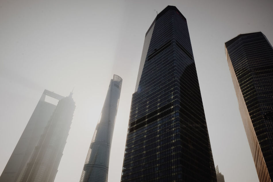Architecture Building Exterior Business Finance And Industry China City City Life Cityscape Clear Sky Day Downtown District Fog Low Angle View Modern Morning Light Morning Sky Natural Light No People Outdoors Sky Skyscraper Urban Skyline