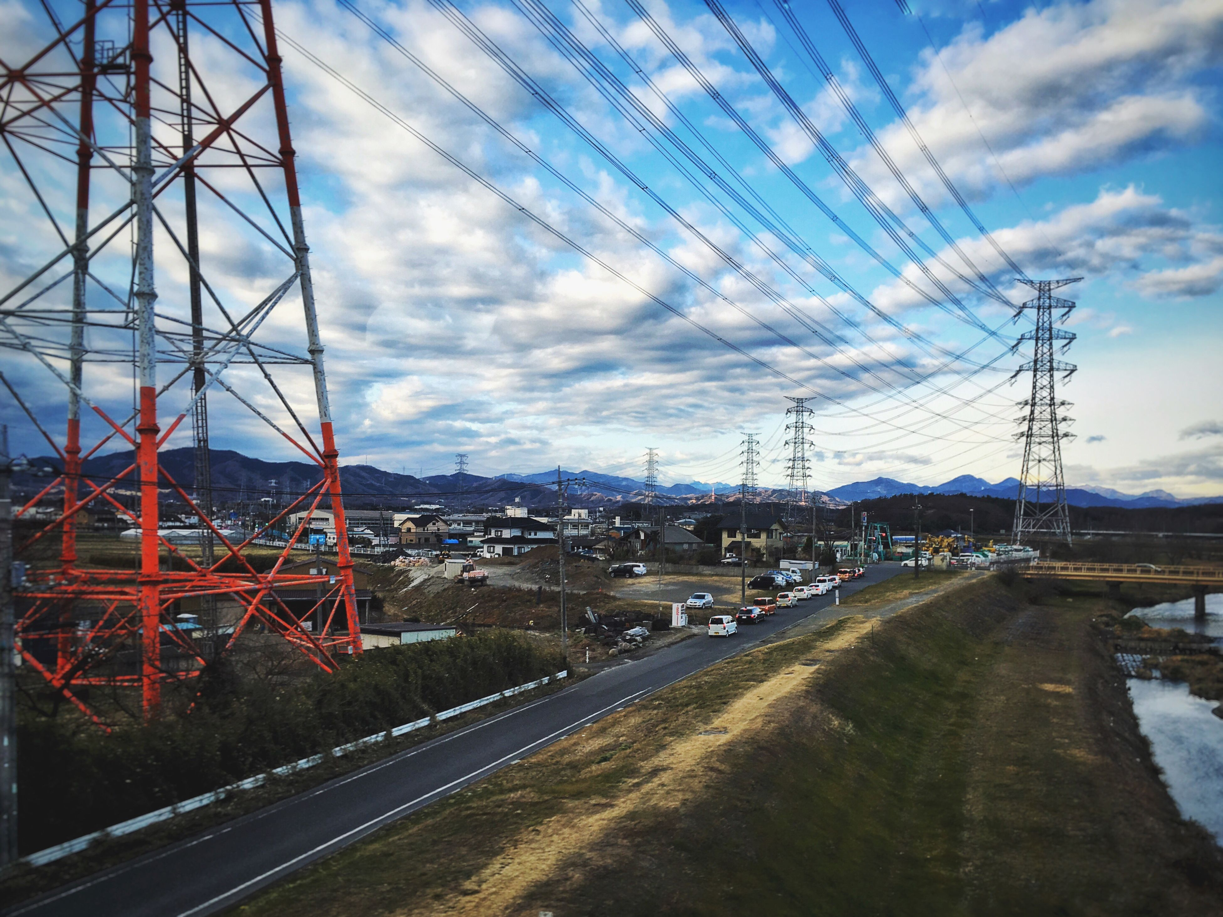 transportation, electricity pylon, connection, electricity, power line, sky, cable, power supply, cloud, the way forward, mode of transport, cloud - sky, mountain, day, blue, outdoors, diminishing perspective, long, track, complexity