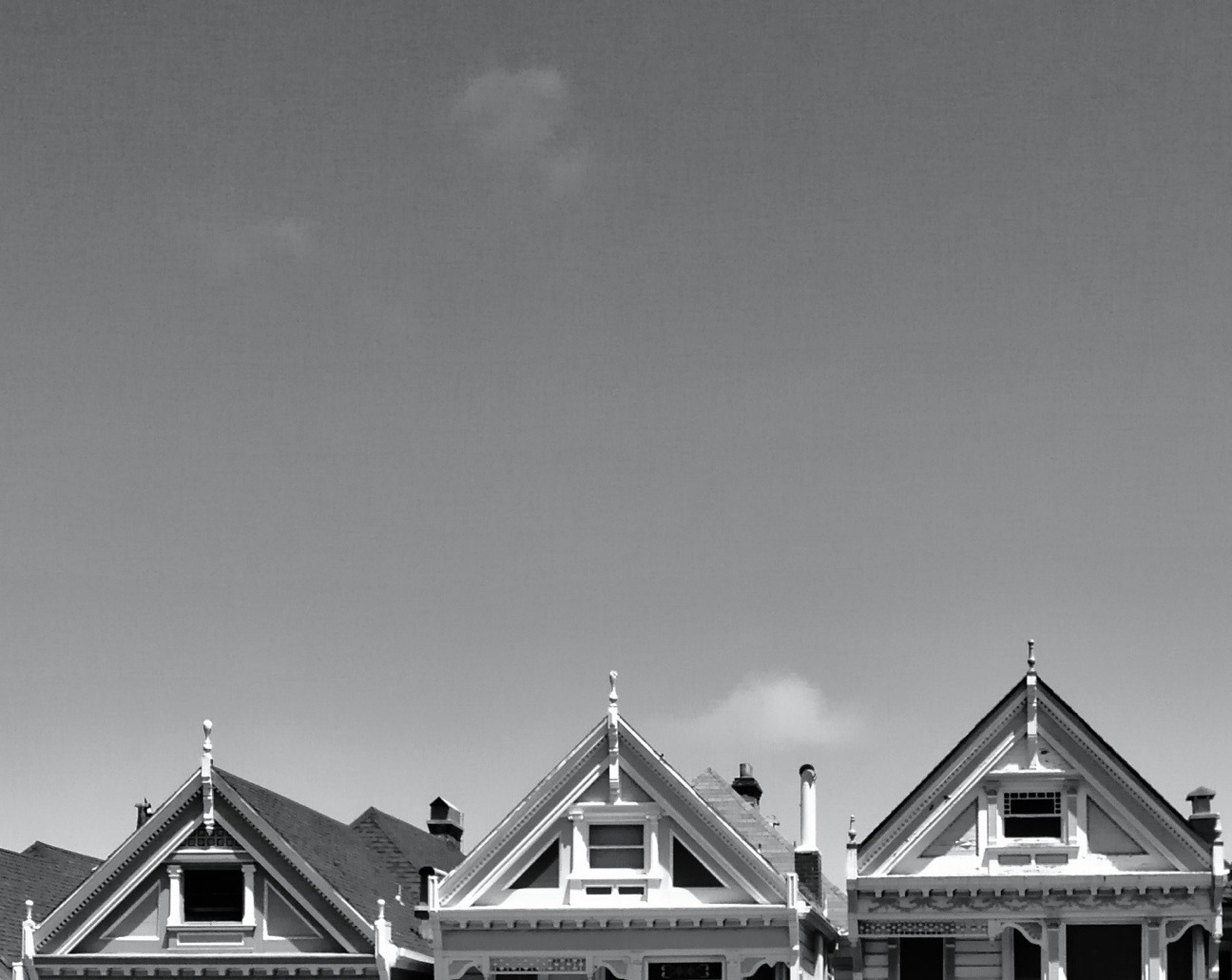 architecture, building exterior, built structure, low angle view, high section, sky, copy space, clear sky, church, religion, outdoors, place of worship, window, day, house, building, no people, spirituality, roof