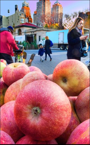 Gala Apples Close Up To Distance Freshness Fruit Gala Apples NYC Skyline Organic People Shopping & Texting Perspective Ripe Union Sq. Mkt., NYV - 11/30/15