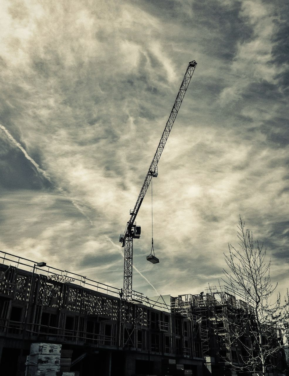 architecture, built structure, building exterior, sky, low angle view, cloud - sky, no people, construction site, outdoors, day, city