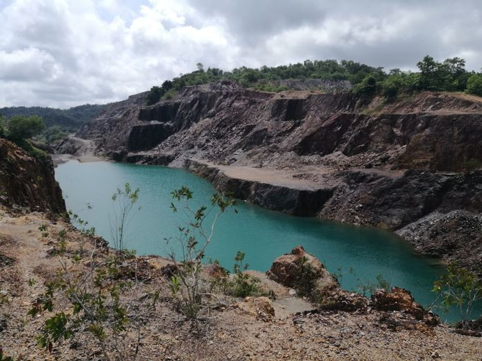 'Blue Lake' a mesmerizing blue but toxic lake of abandoned gold mine in Rhusila, Terengganu, Malaysia. Blue White Green Red Sky Cloud Cloudscape Mine Abandoned Water Lake Cloud - Sky Nature Sky Mountain Outdoors Scenics Landscape Day No People Tree EyeEmNewHere An Eye For Travel