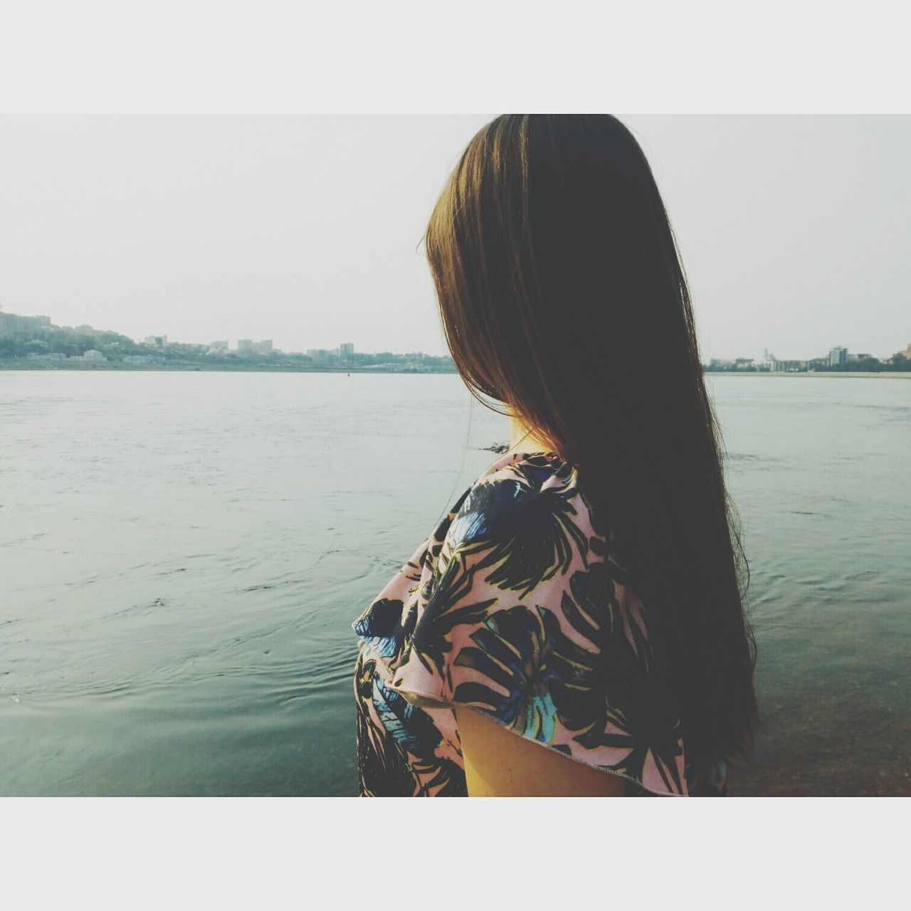 rear view, real people, one person, water, sea, day, leisure activity, nature, clear sky, women, outdoors, standing, lifestyles, tranquility, horizon over water, beach, beauty in nature, sky, nautical vessel, young women, young adult, people