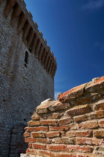 Fortress of the Lion, Castiglione del Lago, Umbria Stone Blue Sky Fortress Fort Historic Fortress Wall Architecture Wall Built Structure Castiglione Del Lago Umbria Italy Historical Building No People Outdoors Medieval Low Angle View Old Ruin History Bricks Brick Wall