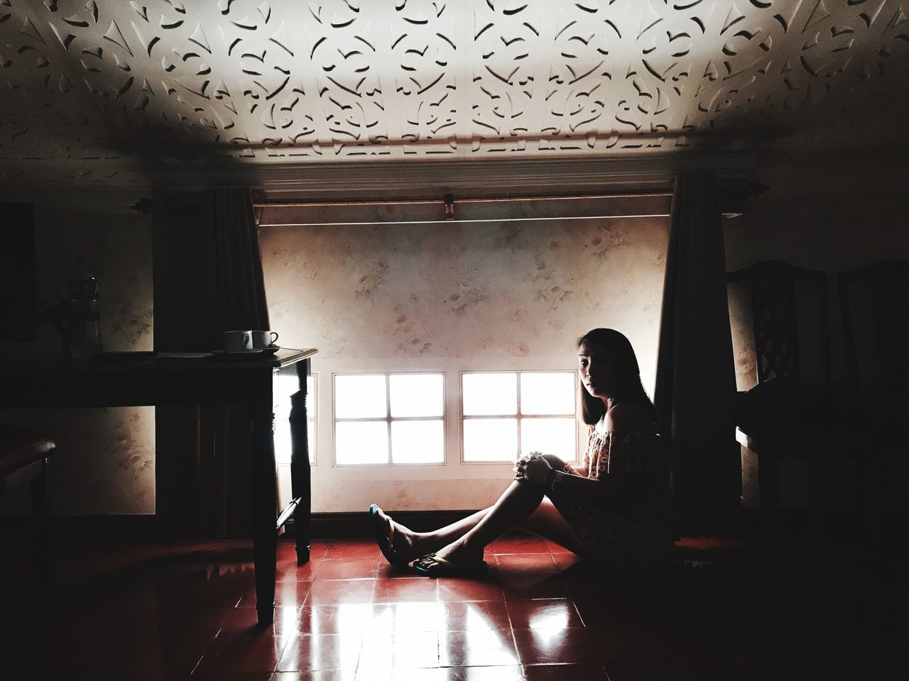 indoors, one person, real people, home interior, window, lifestyles, young women, young adult, women, sitting, day, adult, people