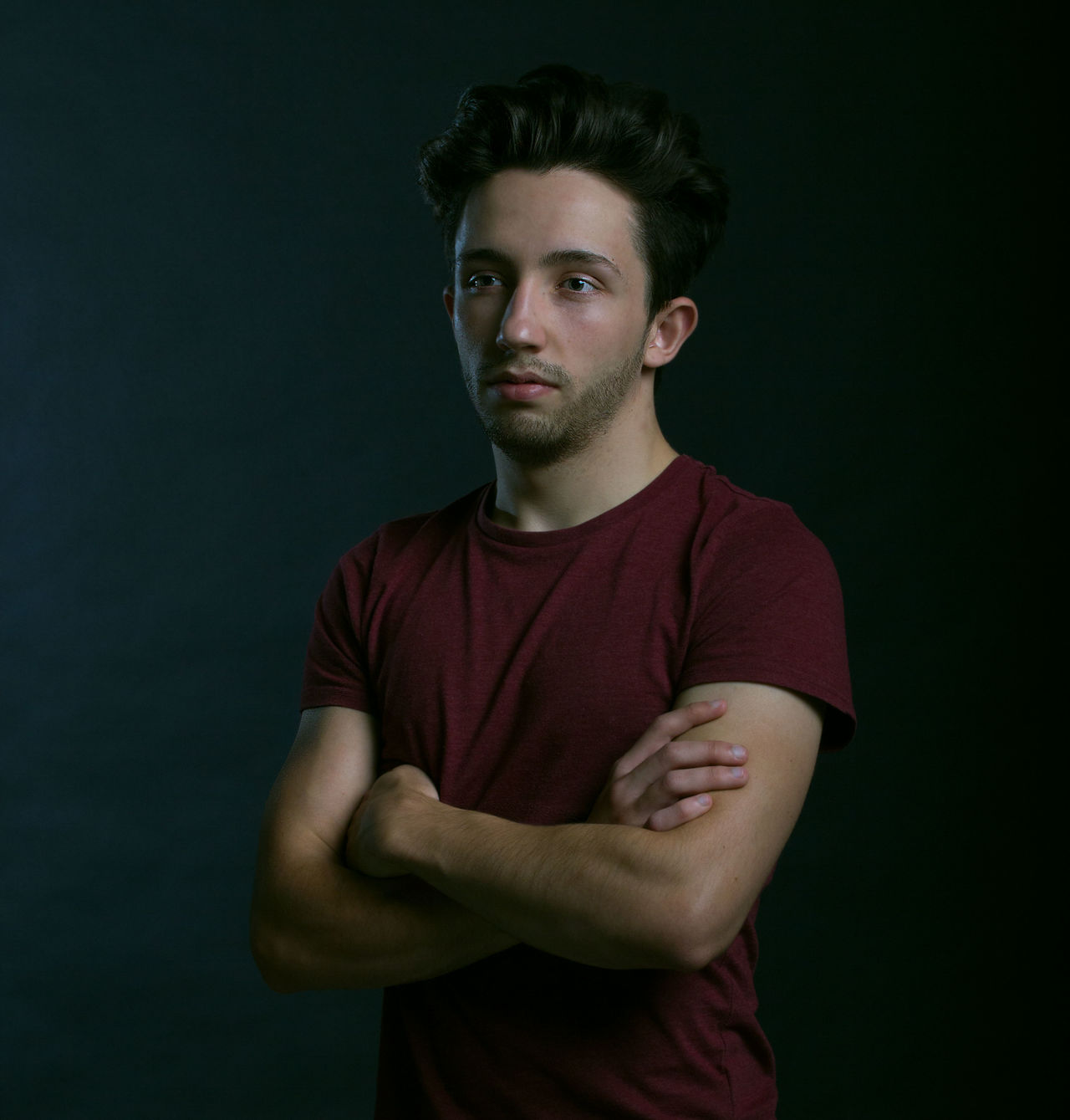 Beautiful stock photos of black background, 20-24 Years, Arms Crossed, Black Background, Casual Clothing