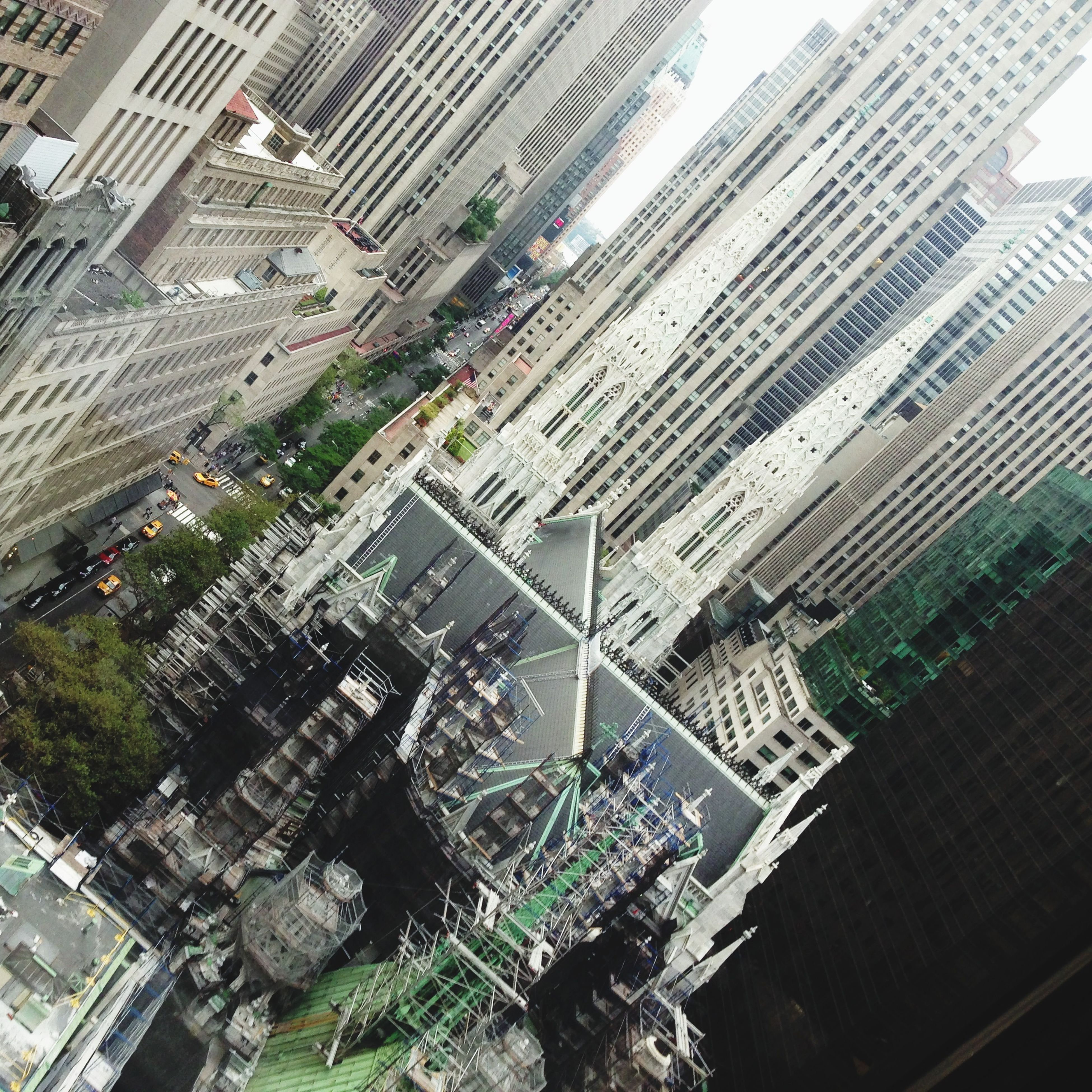 building exterior, architecture, built structure, high angle view, city, residential building, building, cityscape, city life, residential district, residential structure, day, street, incidental people, outdoors, transportation, roof, office building, elevated view, water