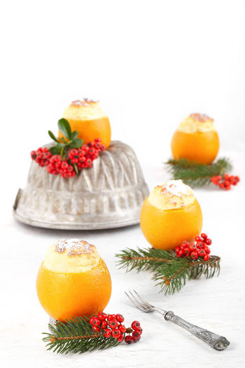 Custard souffle in orange, typical desert for winter holidays. Christmas Dessert Food Styling Food And Drink Orange Souffle Citrus Fruit Cream Custard Decorated Dessert Food Food And Drink Food Photography Food Porn Foodphotography Foodporn Fruit Healthy Eating Ready-to-eat Studio Shot Sweet Food White Background
