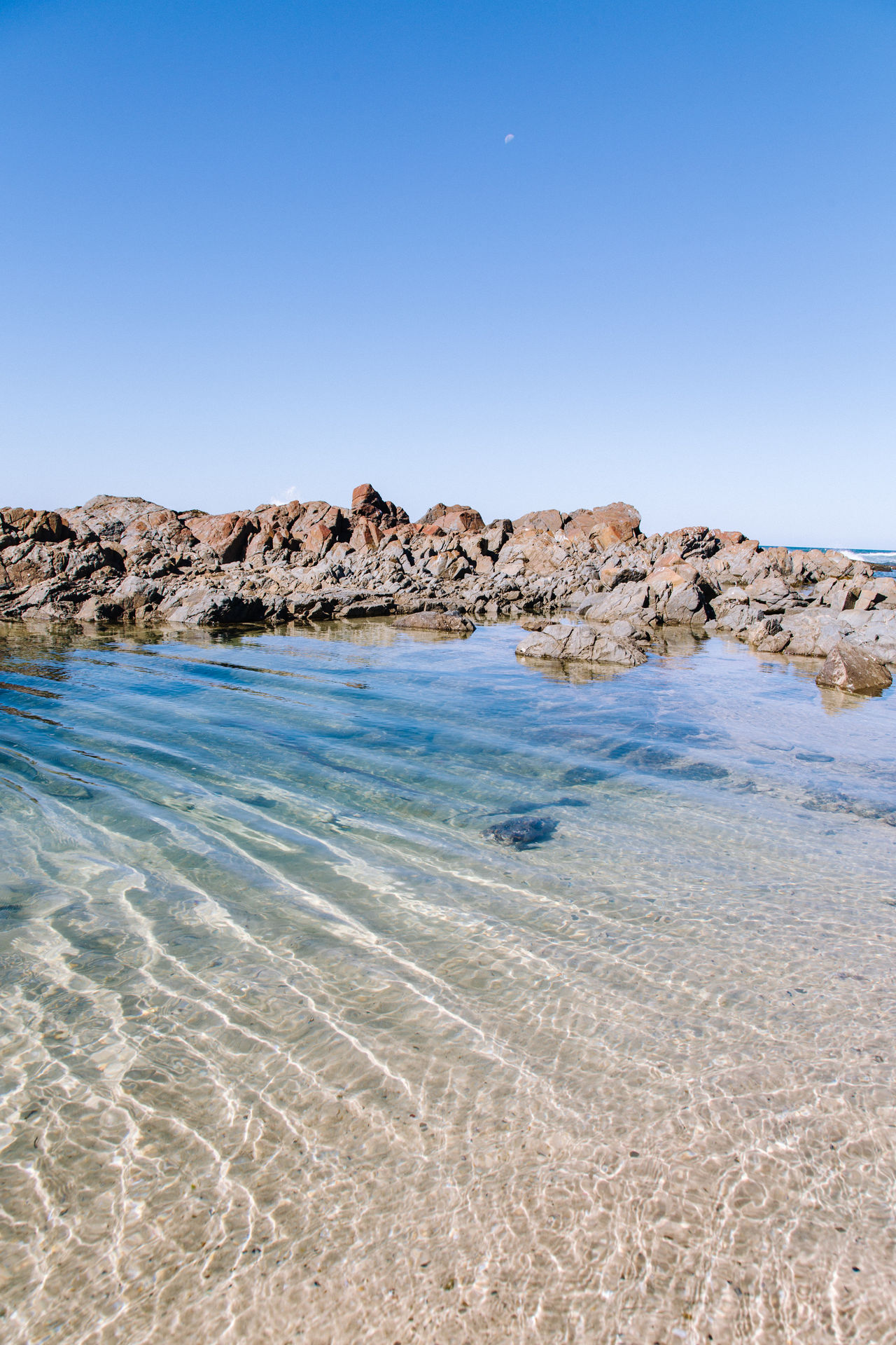 Rock pool Beach Beauty In Nature Blue Clear Sky Day Landscape Nature No People Outdoors Rock - Object Sand Scenics Sea Sky Tranquil Scene Tranquility Travel Destinations Water