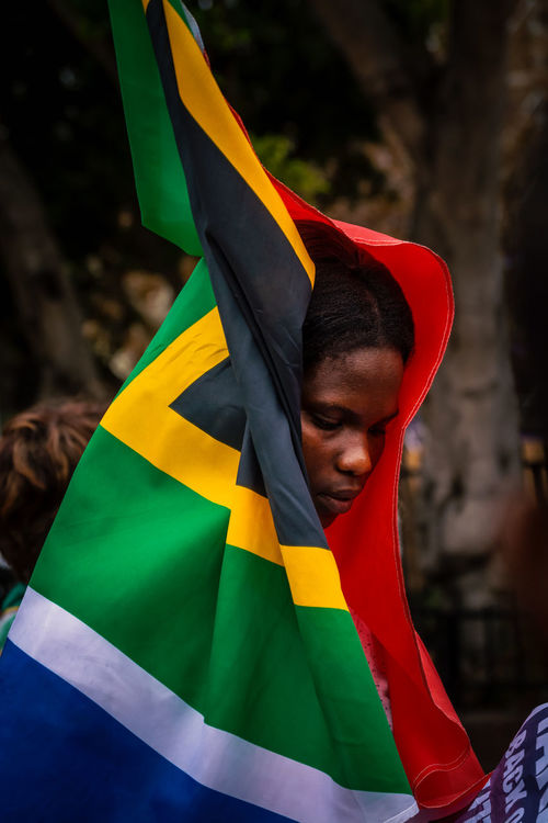 Save South Africa protester Adult Adults Only Black Color Covered In South African Flag Day Flag Long Goodbye Multi Colored One Man Only Outdoors Patriotism People Port Elizabeth Port Elizabeth Protest Portrait Portrait Of A Woman Protest Protester South Africa South African Flag Unity Welcome To Black Yellow Young Adult Zumamustfall Resist The Portraitist - 2017 EyeEm Awards