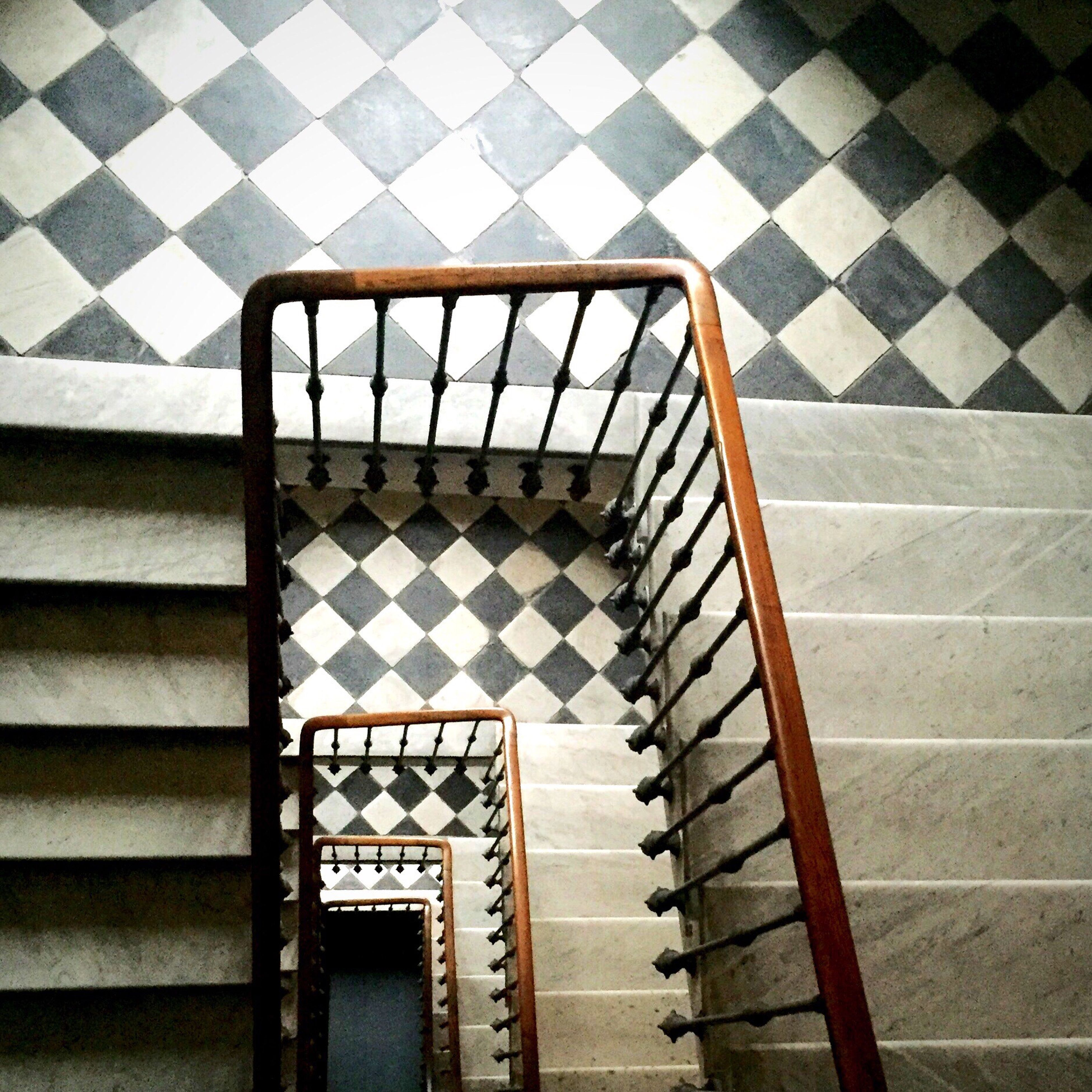 steps, pattern, steps and staircases, railing, staircase, indoors, architecture, built structure, design, high angle view, geometric shape, repetition, sunlight, no people, shadow, day, wall - building feature, in a row, reflection, tiled floor