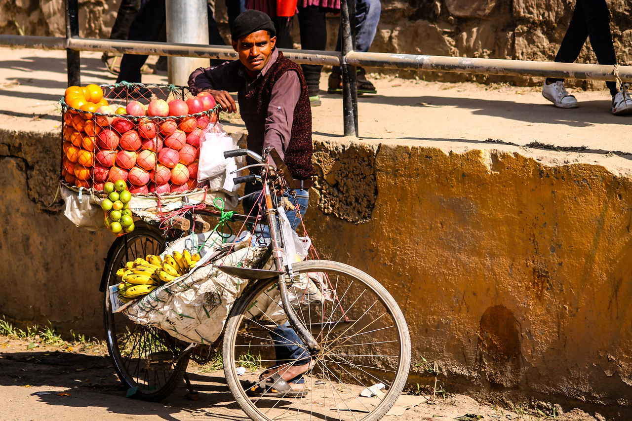 Kathmandu, Nepal Culture And Tradition Travel Photography Travel Shadows & Lights Real People Street Photography People Photography Eyeem Philippines Selling Fruits In The Street Selling Fruits On A Bicycle Fruit Vendor Small Business Working Commerce Transportation Mode Of Transport Food Bicycle Food And Drink Healthy Eating One Person People Freshness Rural Scene