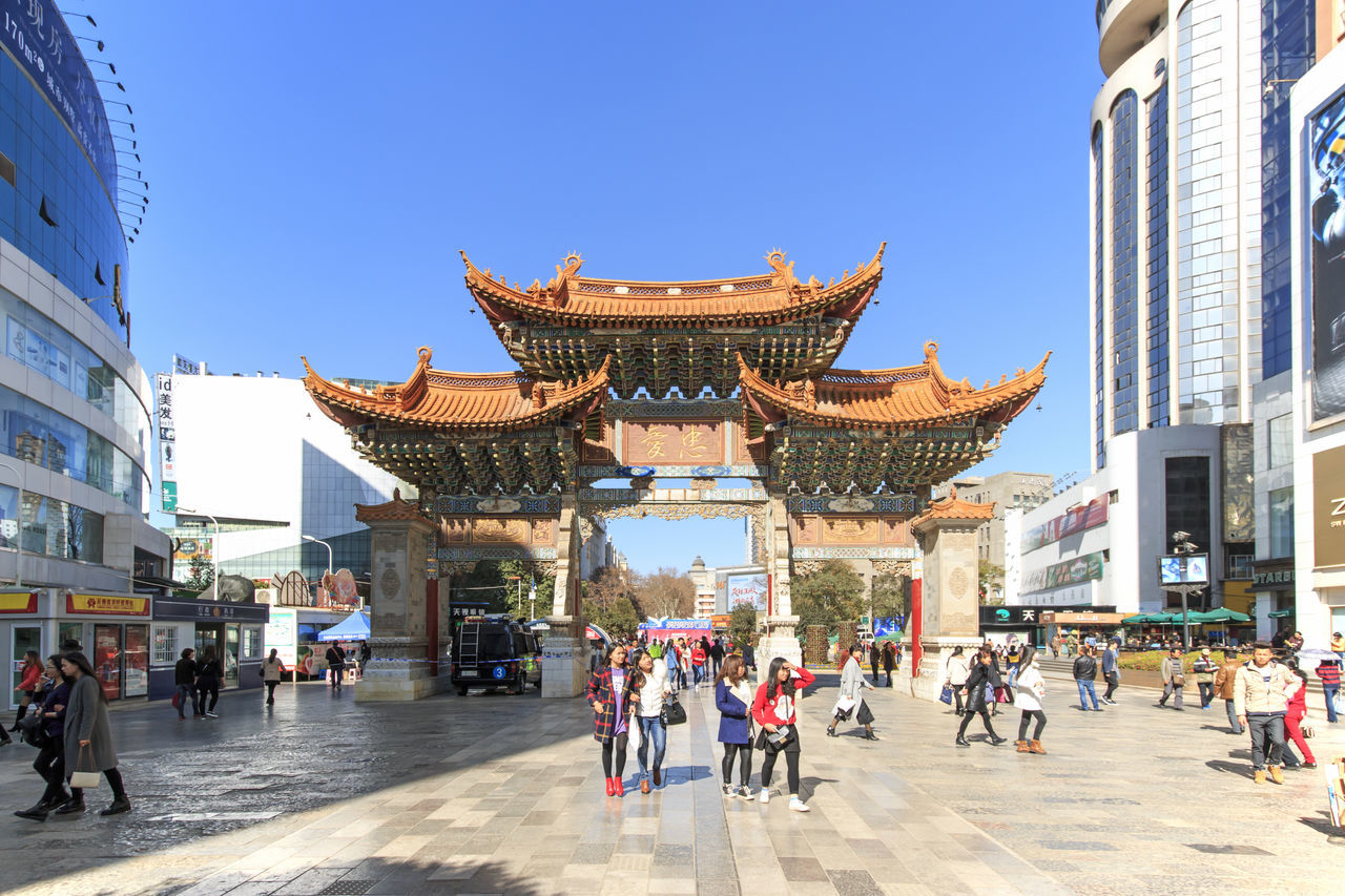 Kunming, China - January 12, 2016: Tourists walking in the city center of Kunming in China Architecture ASIA Blue Building Exterior Built Structure China City City City Life Crowd Cultures Day Far East Kunming Kunming, China Large Group Of People Leisure Activity Lifestyles Main Square Mixed Age Range Person Tourism Tourist Travel Destinations Vacations
