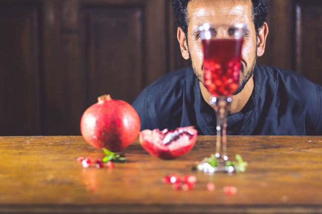 Celebration Check This Out Exceptional Photographs EyeEm Best Shots First Eyeem Photo Focus Object Food Food And Drink Foodphotography Fruit Headshot Hello World Indoors  Juice One Man Only Pomegranate Pomegranates  Portrait Red ShareTheMeal Smoothie Soft Drink Studio Shot Table Unrecognizable Person
