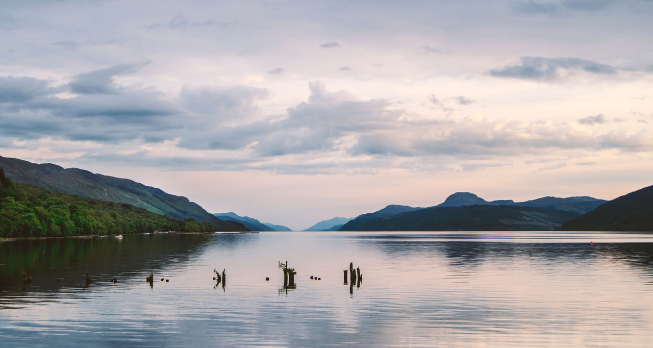 Nessy? Beauty In Nature Cloud Day Forest Lake Landscape Loch Ness Loch Ness Monster Monster Mood Nature No People Outdoors Reflection Scotland Sky Sky And Clouds Sunset Sunset_collection Tourism Tranquility Travel Destinations Traveling Wanderlust Water