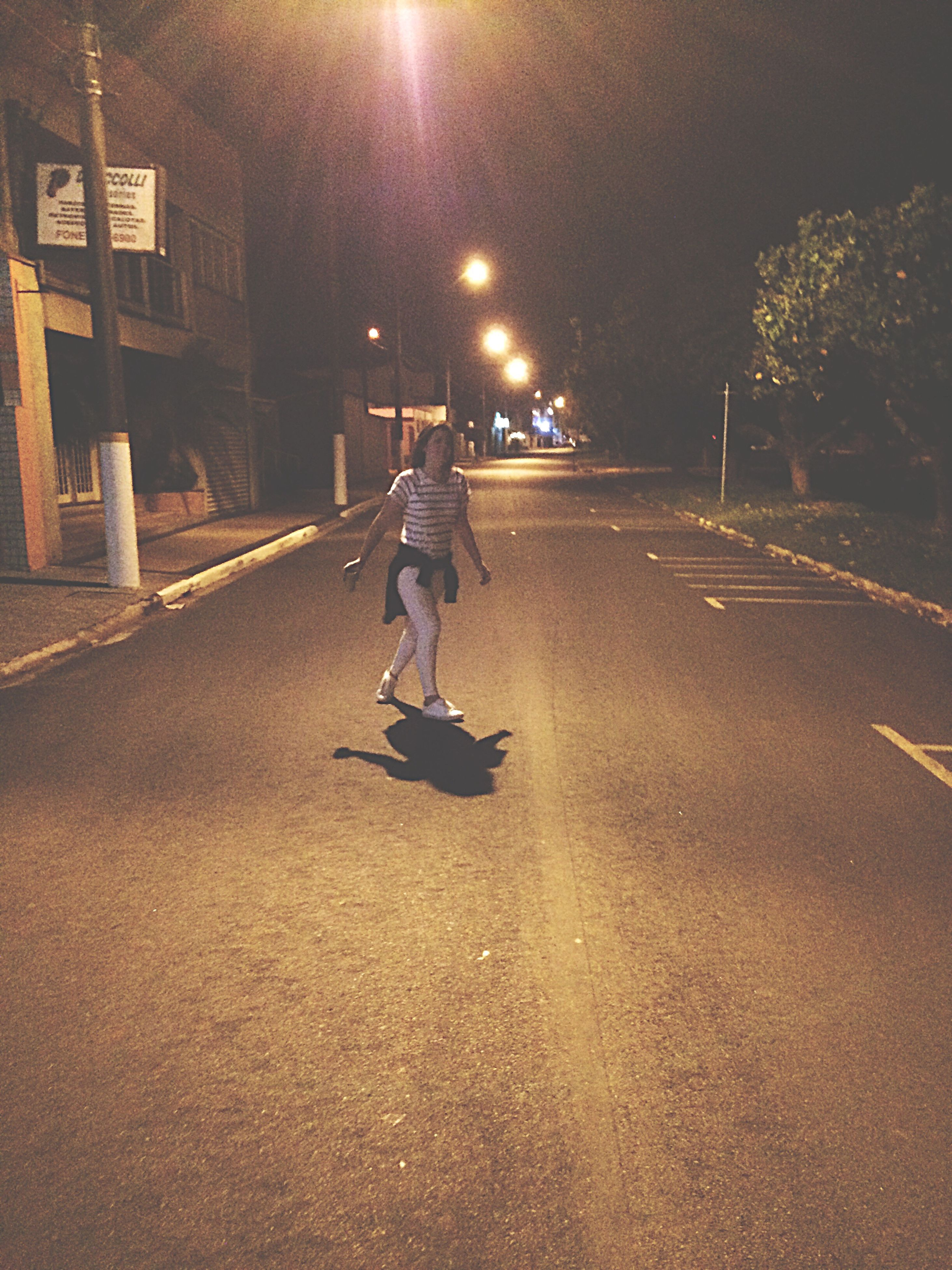 full length, illuminated, street, road, walking, night, adventure, casual clothing, outdoors, electric light, extreme sports, sky, city life, the way forward