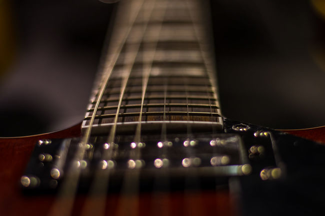 A studio shot , part of a guitar, showing depth and dimension, wires, bodies and pick-ups. Abstract Photography Acoustic Guitar Close-up Extreme Close-up Guitar Hobbies Music Musical Instrument Part Of Selective Focus String Instrument Studio Photography Studio Shot Tall