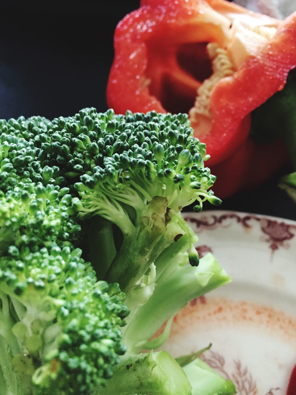 Close-Up Of Raw Broccoli And Red Bell Pepper