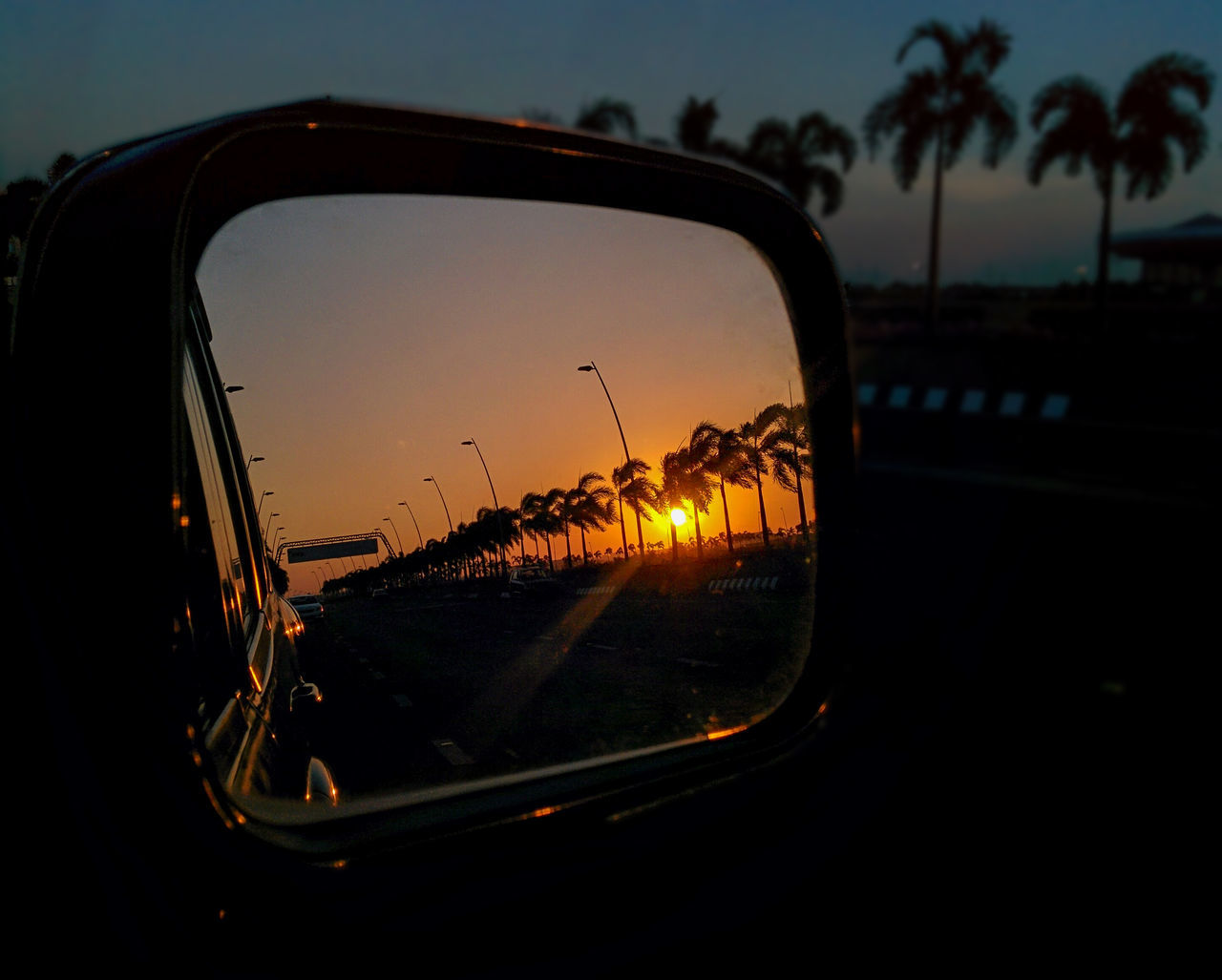 side-view mirror, sunset, transportation, car, land vehicle, mode of transport, reflection, sky, road, no people, road trip, outdoors, nature, landscape, close-up, water, day, beauty in nature