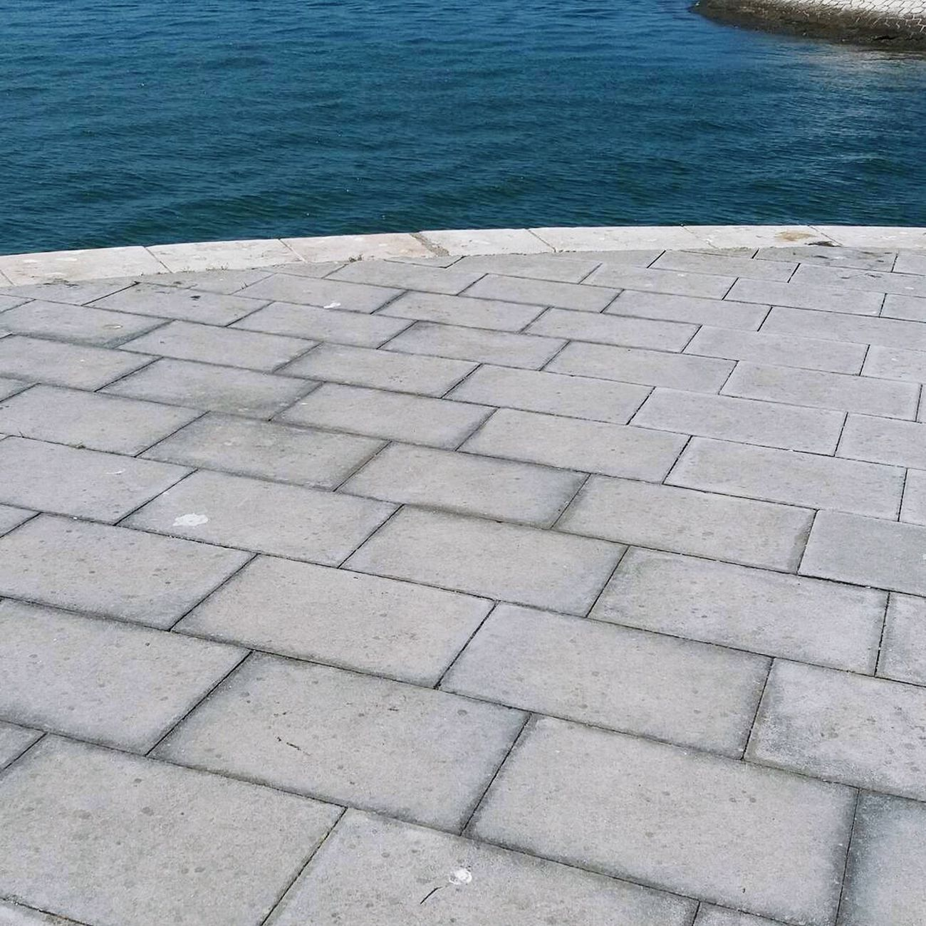 Perspectives in blue Water Asphalt Casual Photography City Lines And Shapes Lines, Shapes And Curves Geometric Shape Belém, Lisboa Belem Portugal Photographing Streetphotography Casualphotography Photography Paving Stone Famous Tourist Attractions Scenics Clear Sky Calm Travel Destinations Belém Marina Tranquility Day Boat Nautical Vessel