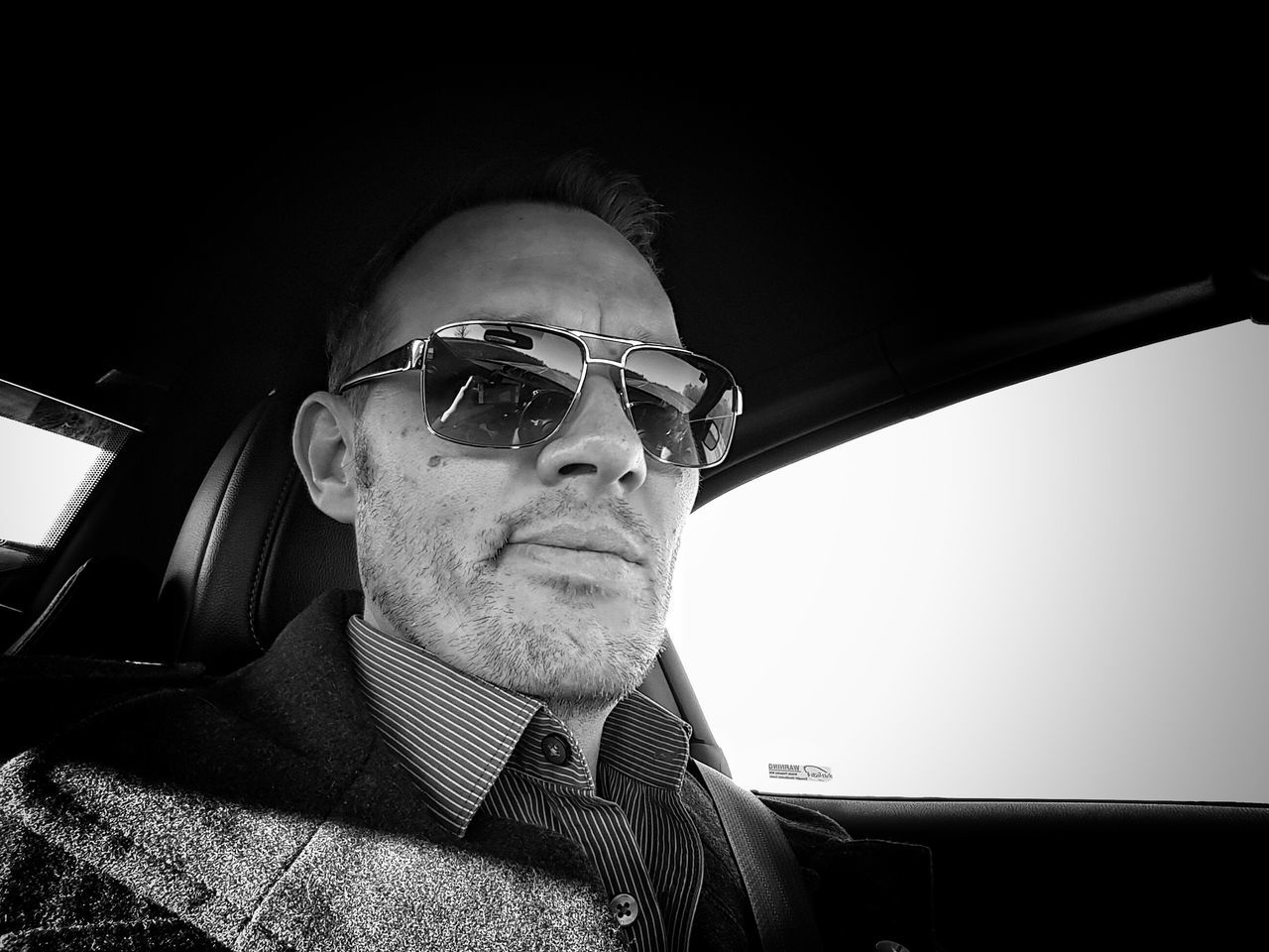 A portrait of a scruffy Englishman (me) One Man Only Headshot Close-up Selfie ✌ Stubblephotography Stubble Reflective Sunglasses Blackandwhite Black And White Photography In A Car Vanity