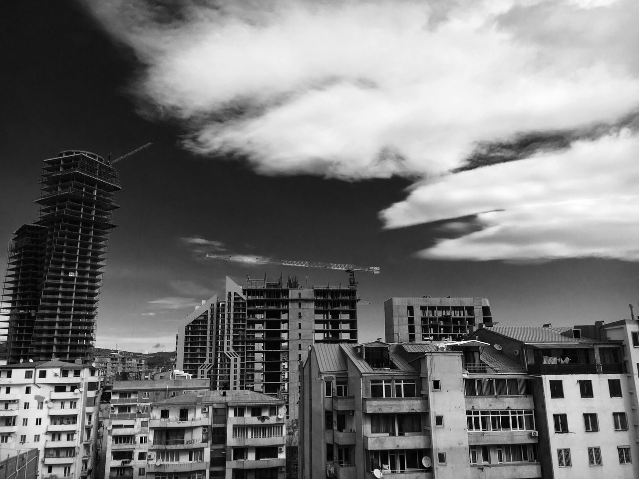 B&W construction site 🏗🔨🏢 Building Exterior Architecture Built Structure City Sky Cloud - Sky No People Skyscraper Outdoors Day Cityscape Balcony View Clouds And Sky Windows Balconies Crane Construction Construction Site Tbilisi Georgia Block Of Flats Old And New Architecture Old And New Cloud Porn Flying High
