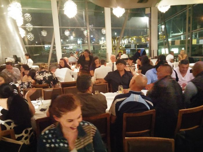 A Busy Night at Mikano Restaurant in Auckland at Mechanics Bay New Zealand Great Atmosphere Fine Dining Cuisine People Large Group Of People Adult Incredible Views Helicopters Work Function Christmas Party Saturday Night with Ono.