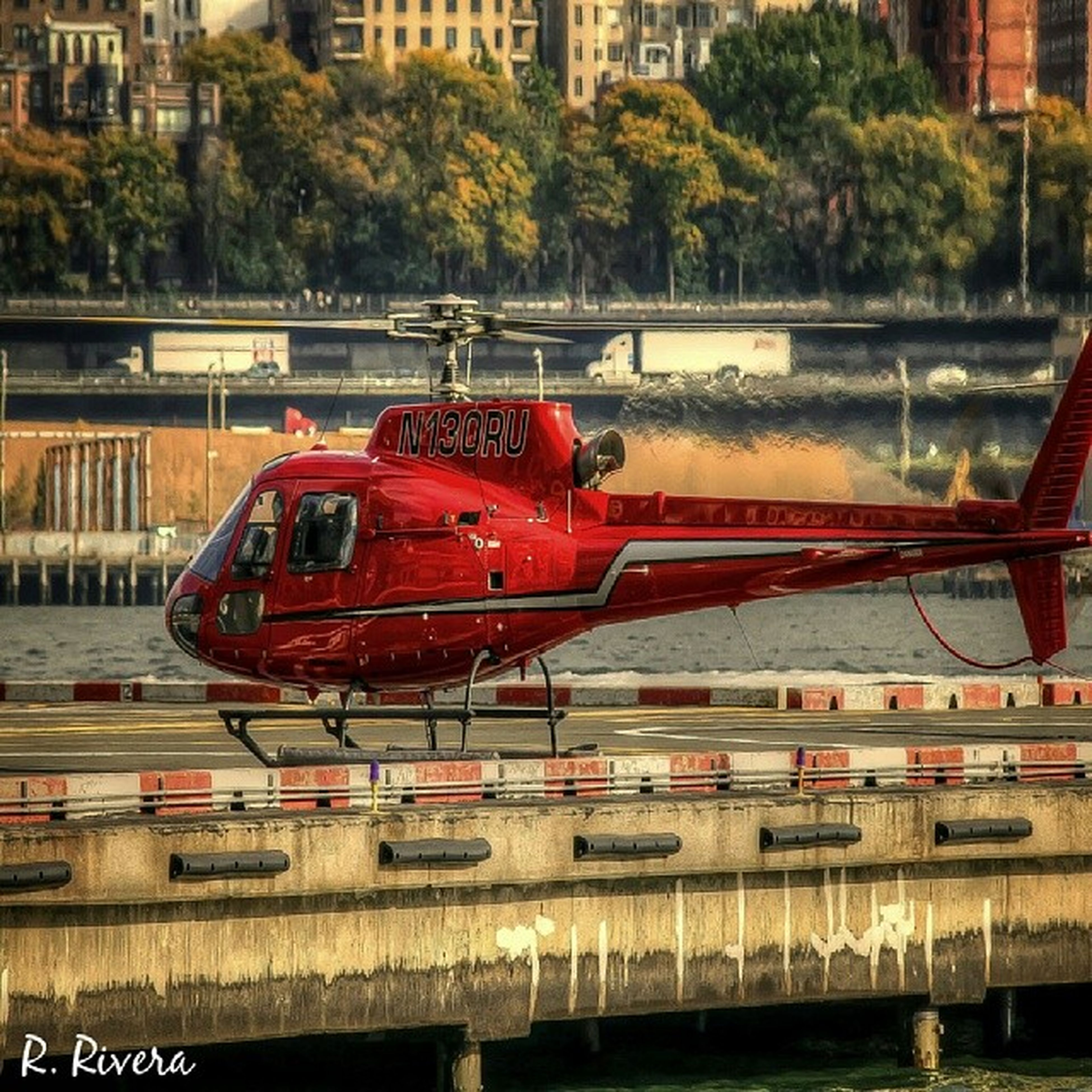 transportation, mode of transport, red, built structure, nautical vessel, architecture, public transportation, river, building exterior, city, train - vehicle, travel, bridge - man made structure, water, boat, railing, land vehicle, train, connection, outdoors
