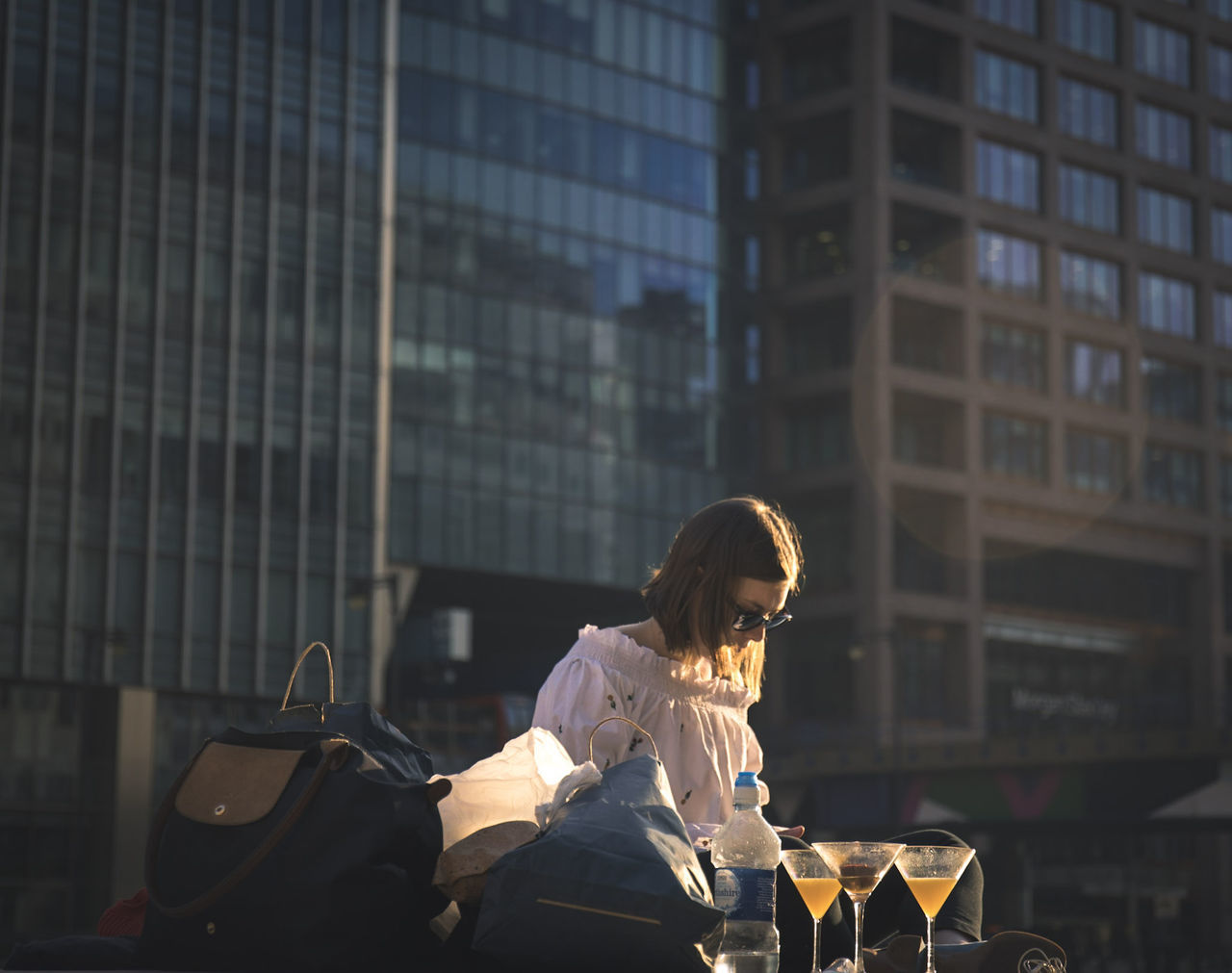 Summer in the city - in the evening o e needs a drink and to unwind -Lovin' spoinful's 1966 hit is now in my head One Woman Only Adults Only Skyscraper Outdoors Building Exterior Built Structure Canon5dmarkiv Day Liveforthestory Canonphotography Canonuk Canon @canonuk Rimlight Drinks Drinking Golden Light London Canary Wharf