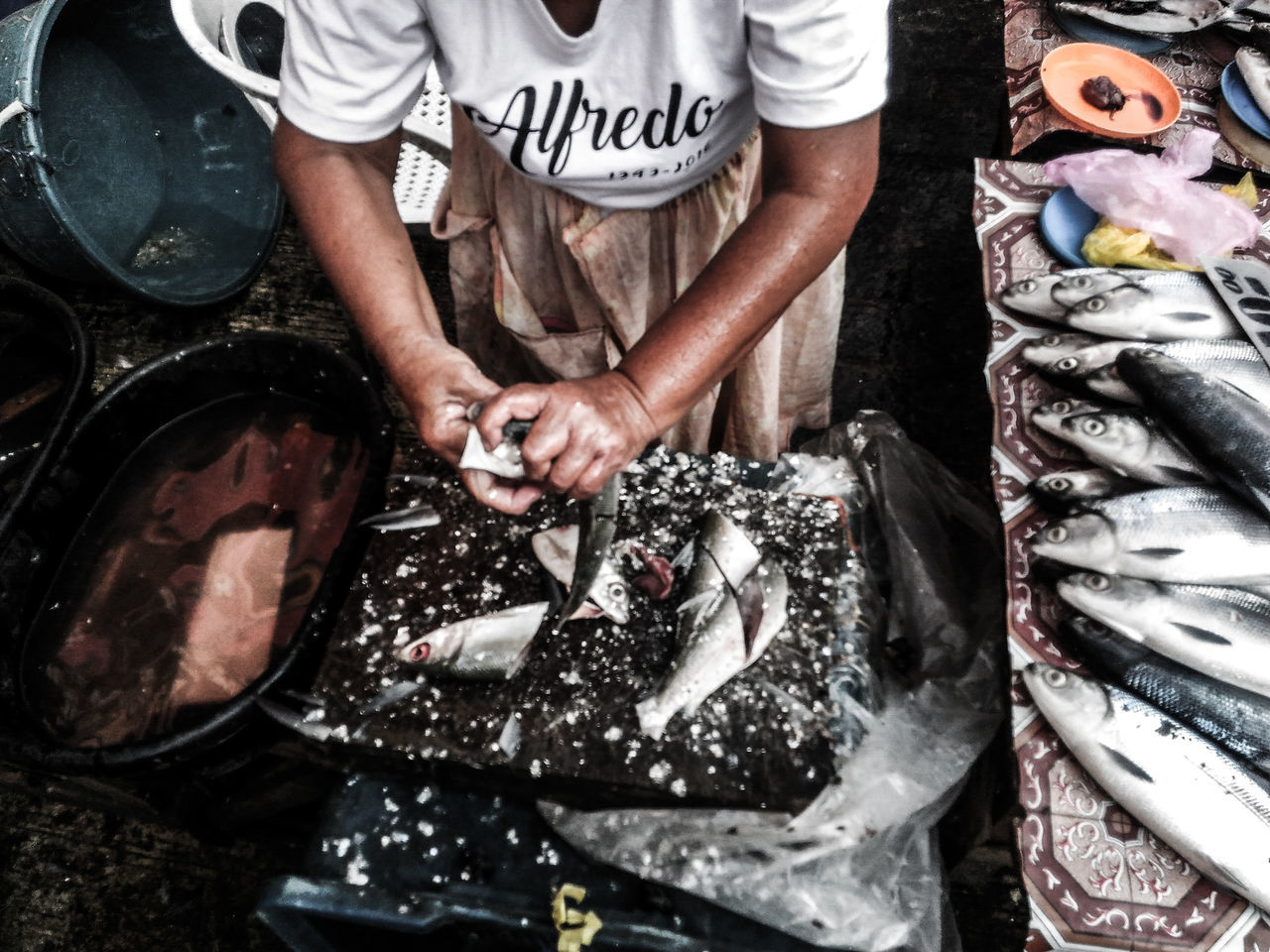 Nanay, in here late 70s (AFAIK), still works as a fish vendor. One Person Labor Day Working Eyeem Philippines Philippines Labor Day Philippines Outdoors Working Hands Streetphotography Street Photography EyeEmPHLaborDay2017 The Photojournalist - 2017 EyeEm Awards The Street Photographer - 2017 EyeEm Awards