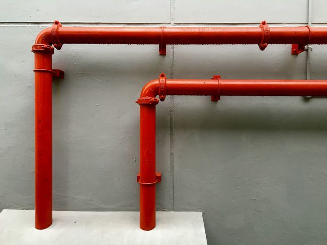 Red pipes against white wall Artistic Red Red Piping Red Tubes Red And White Red Against White Background Composition Colours Water Piping Gas Pipes