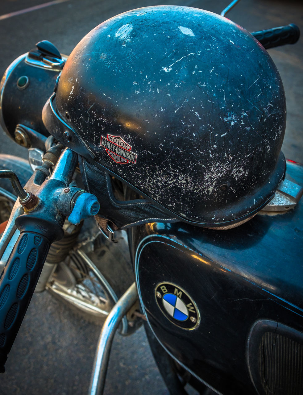motorcycle, transportation, mode of transport, bicycle, land vehicle, helmet, stationary, day, outdoors, headwear, close-up, no people