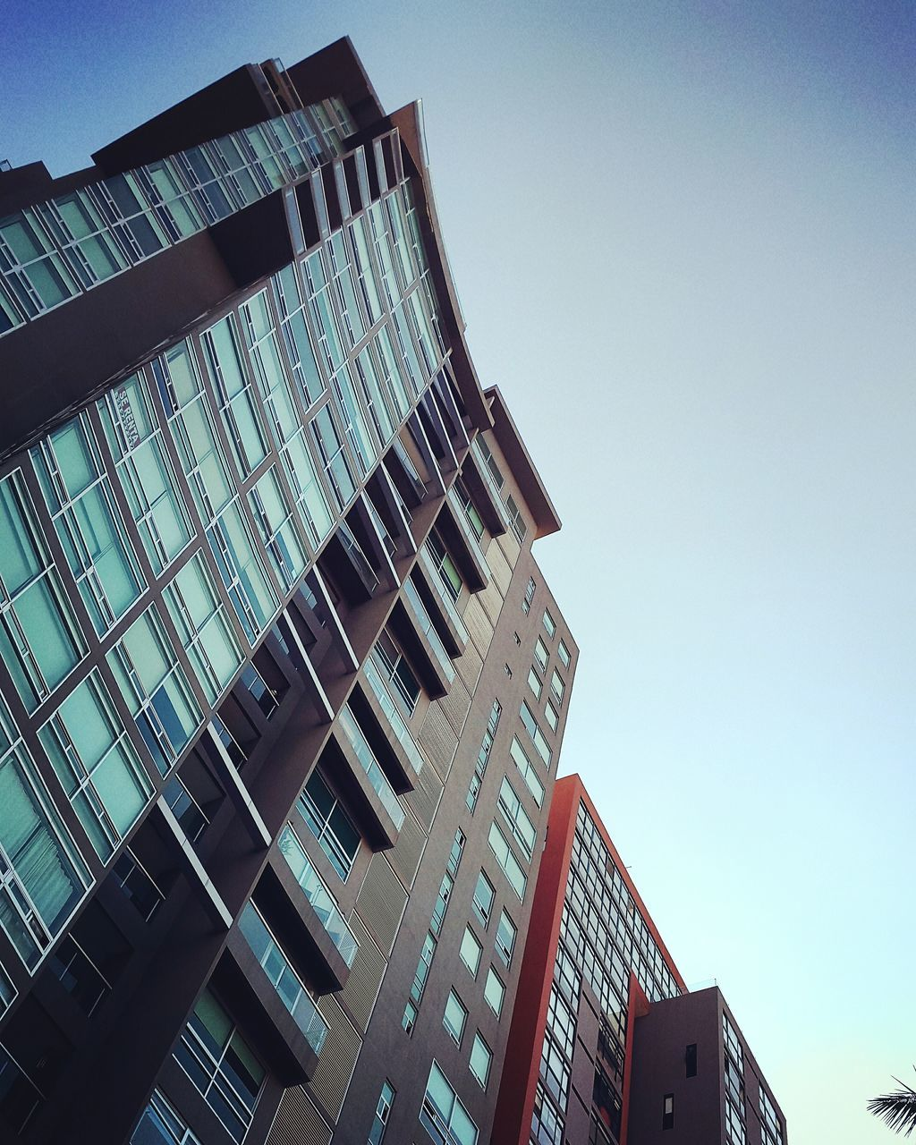architecture, modern, building exterior, skyscraper, built structure, low angle view, city, clear sky, tall, no people, outdoors, day, sky