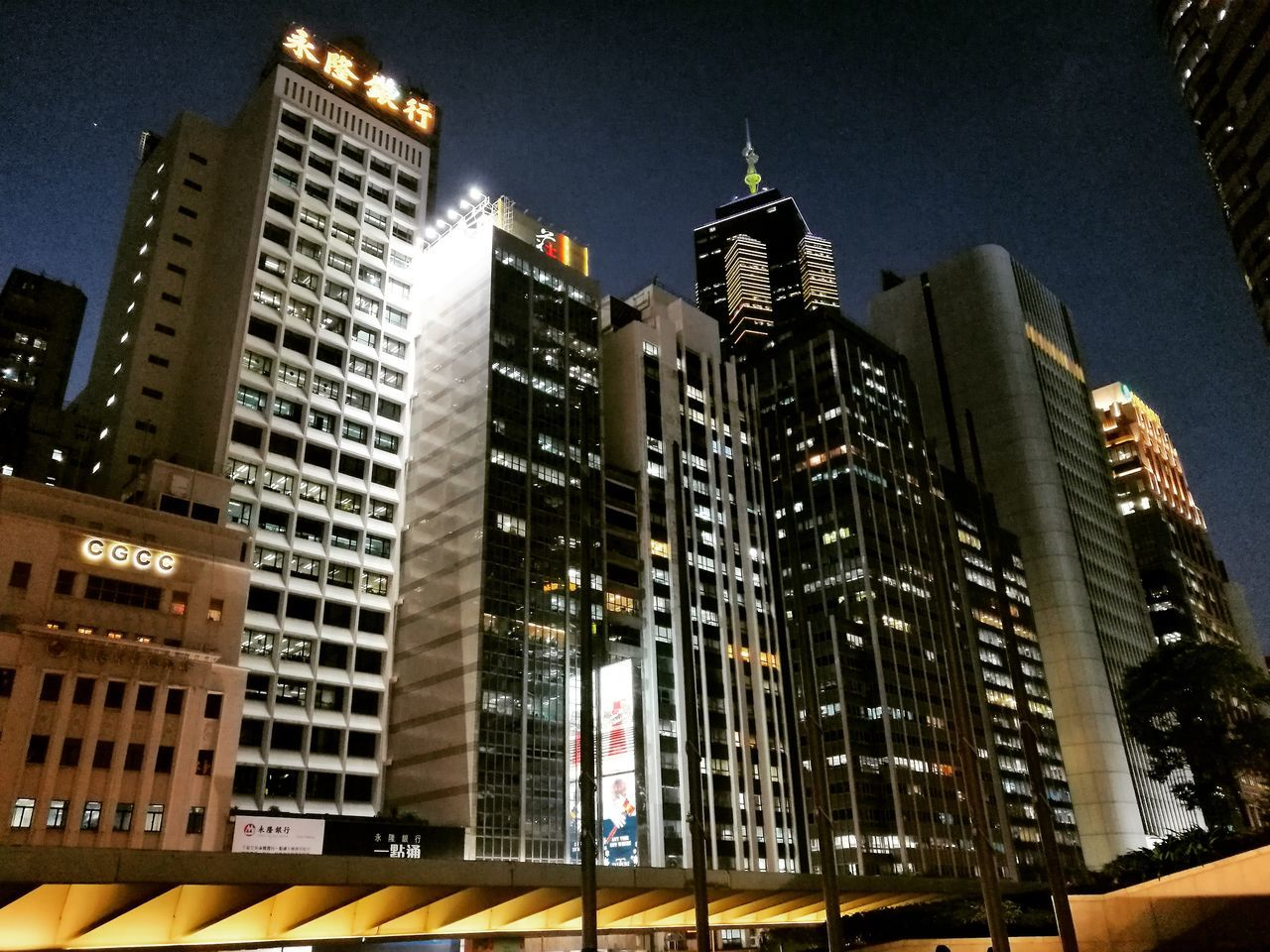 architecture, building exterior, skyscraper, city, urban, built structure, night, modern, no people, low angle view, illuminated, tall, cityscape, outdoors, sky