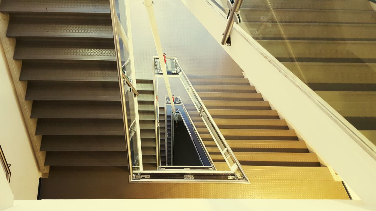 staircase, steps and staircases, steps, railing, stairs, architecture, built structure, hand rail, indoors, high angle view, stairway, modern, no people, day